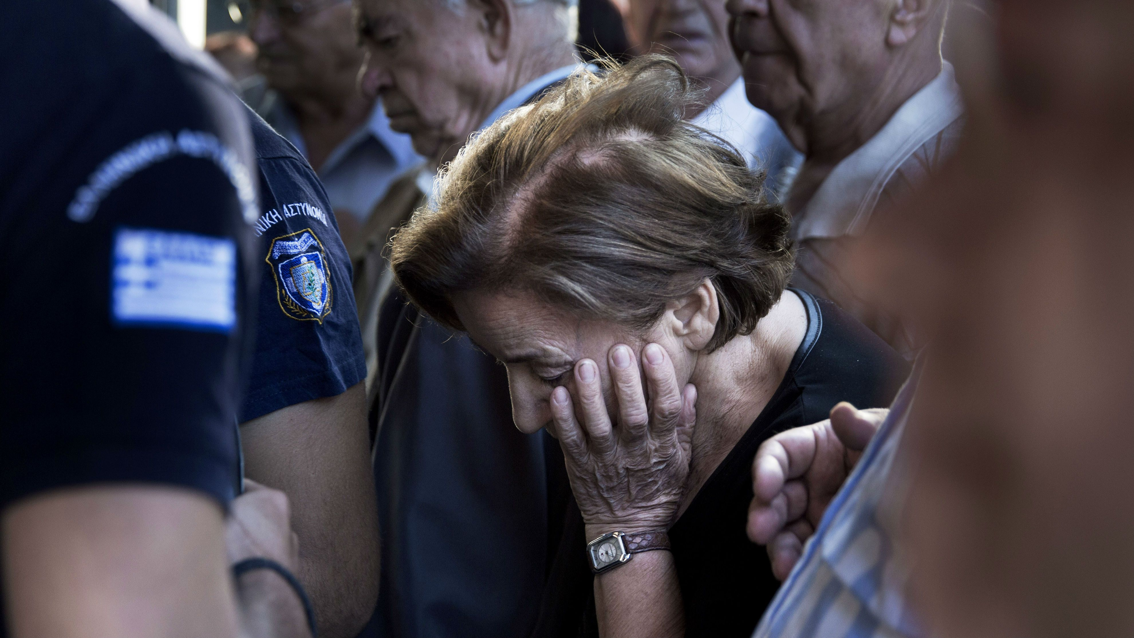 Pensioners crowd the entrance of bank in Athens, Wednesday, July 1, 2015. Long lines formed as bank branches around the country were ordered by Greece's government to reopen Wednesday to help desperate pensioners without ATM cards cash up to 120 euros ($134) from their retirement checks. (AP Photo/Petros Giannakouris)