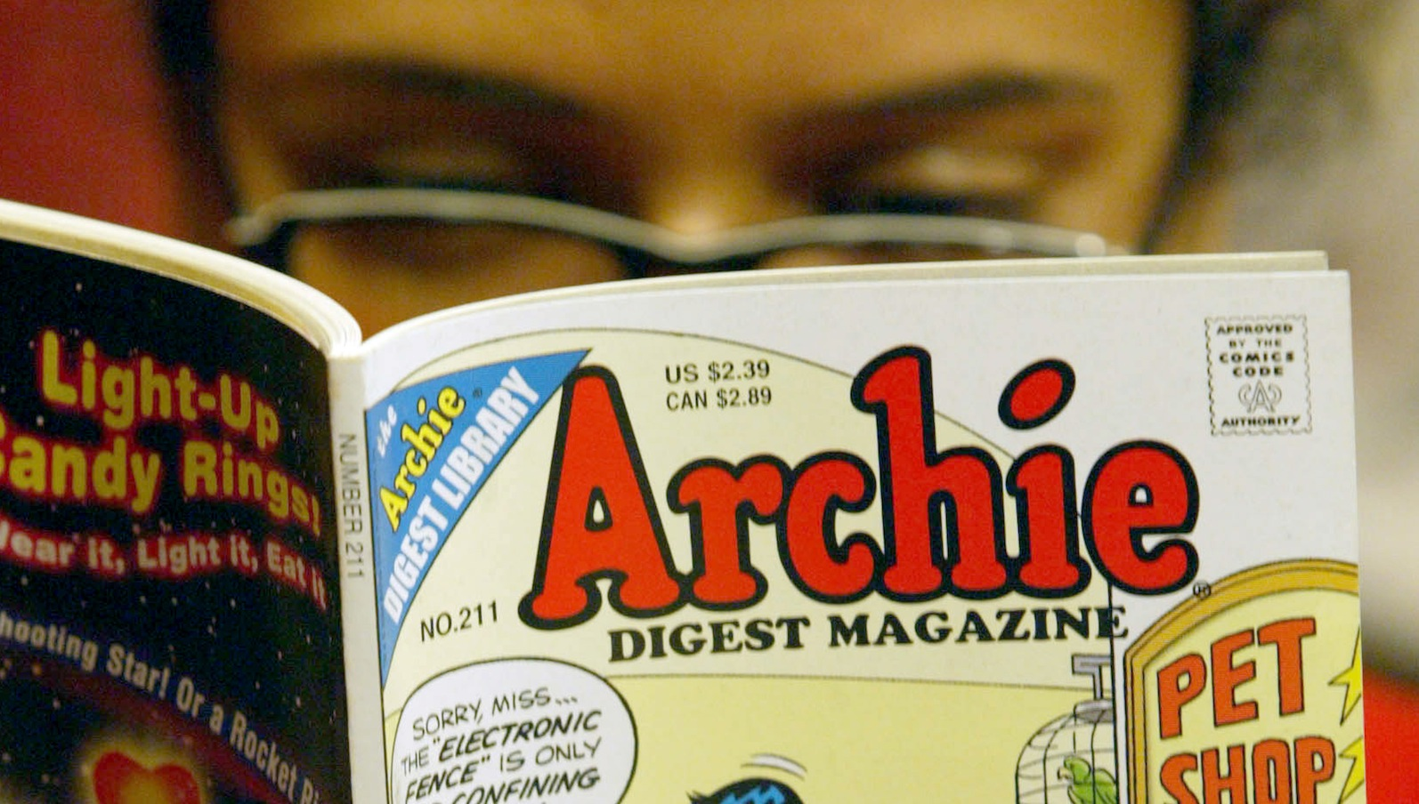 In this Monday, May 7, 2007, file photo, a girl reads an Archie comic at Oxford Book Shop in Calcutta, India. The two CEOs of the company that publishes Archie comics on Wednesday, June 6, 2012, ended their court feud over control of the comics kingdom, but now some relatives are accusing both sides of funny business.