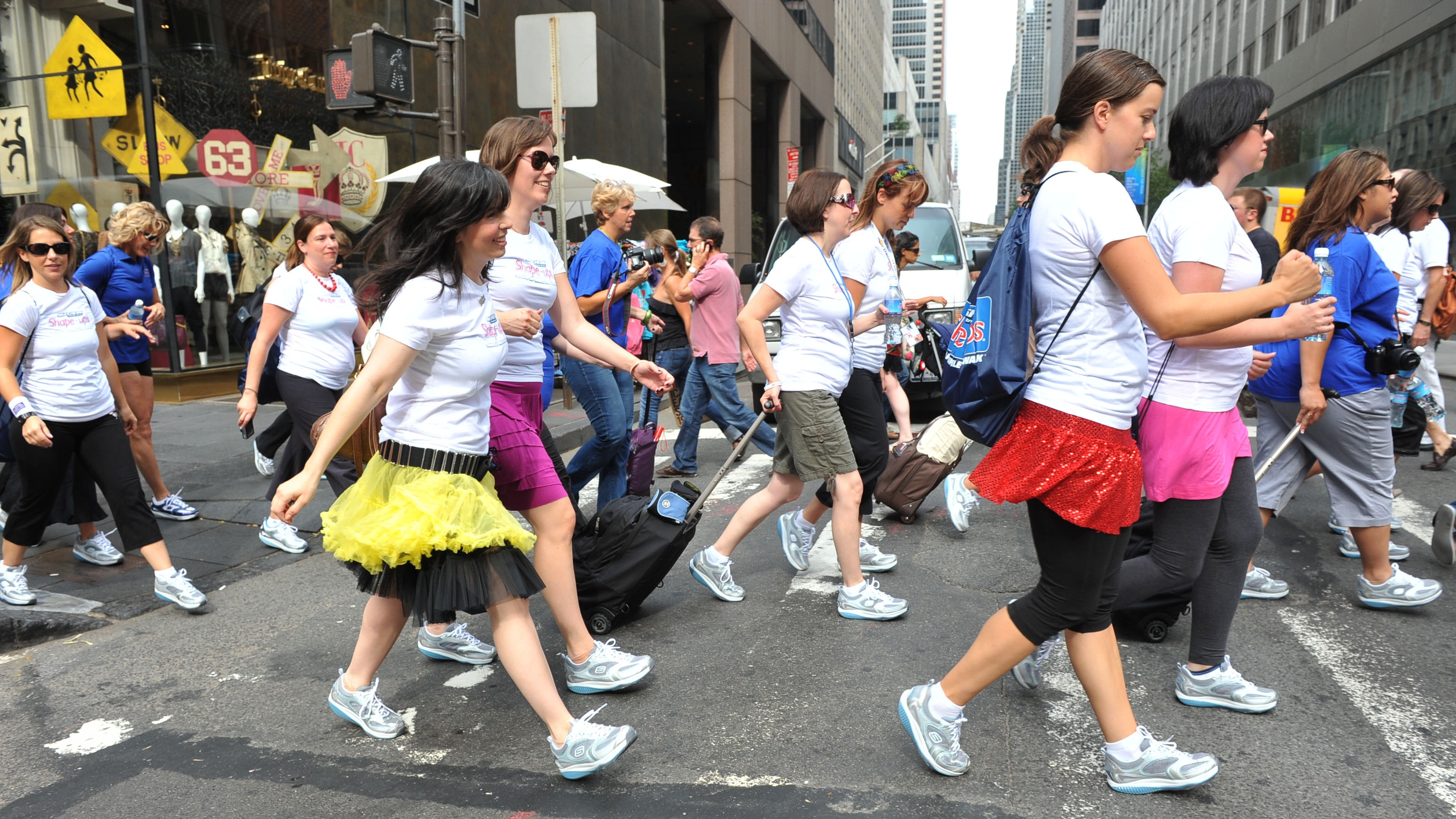 """In this photograph taken by AP Images for SKECHERS, Beauty and mommy bloggers, outfitted in SKECHERS Shape-ups, participated in a fitness walk up Fifth Avenue en route to the """"Getting Gorgeous"""" event, Friday, Aug. 6, 2010, in New York, to experience the benefits of Shape-ups – the sneakers that provide a fun and easy way to tone and improve strength and posture."""