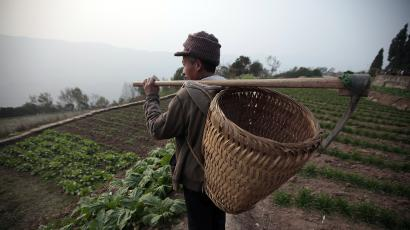 In this Feb. 4, 2011 photo, Li Weishu, father of migrant worker Li Biying, looks at his farm at the Li family's house in Sanxing, China.