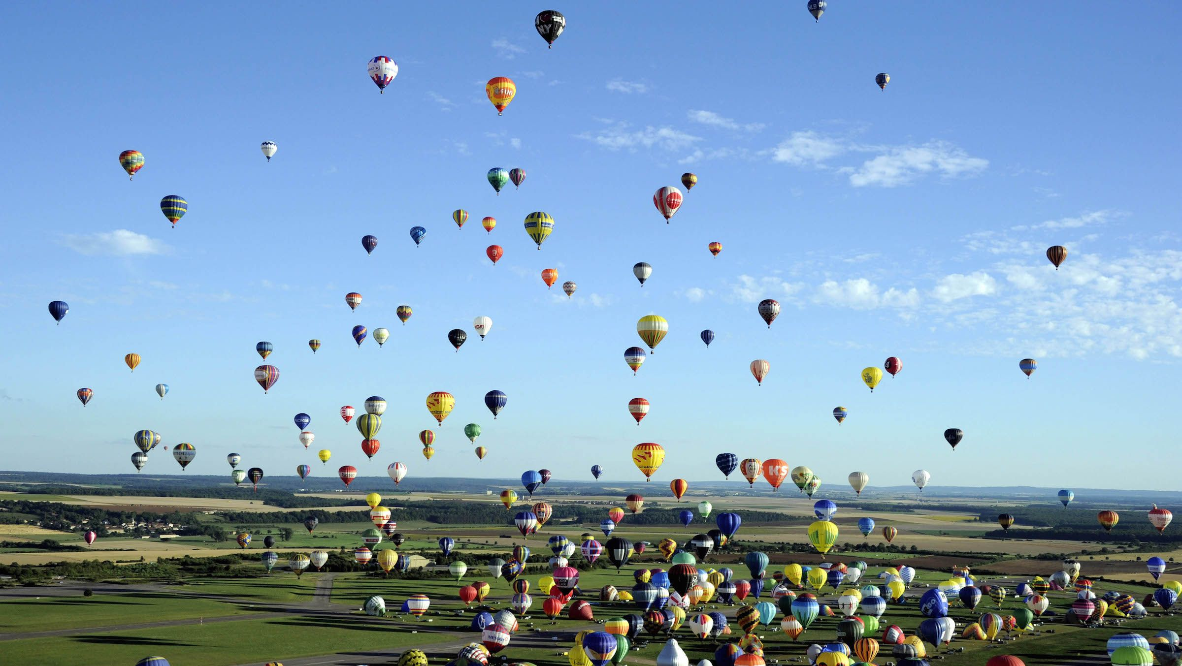 """Over four hundred  hot-air balloons prepare to take off in Chambley-Bussieres, eastern France, on Wednesday, July 31, 2013 in an attempt to set a world record for collective taking-off during the event """"Lorraine Mondial air ballons"""", an international hot-air balloon meeting."""