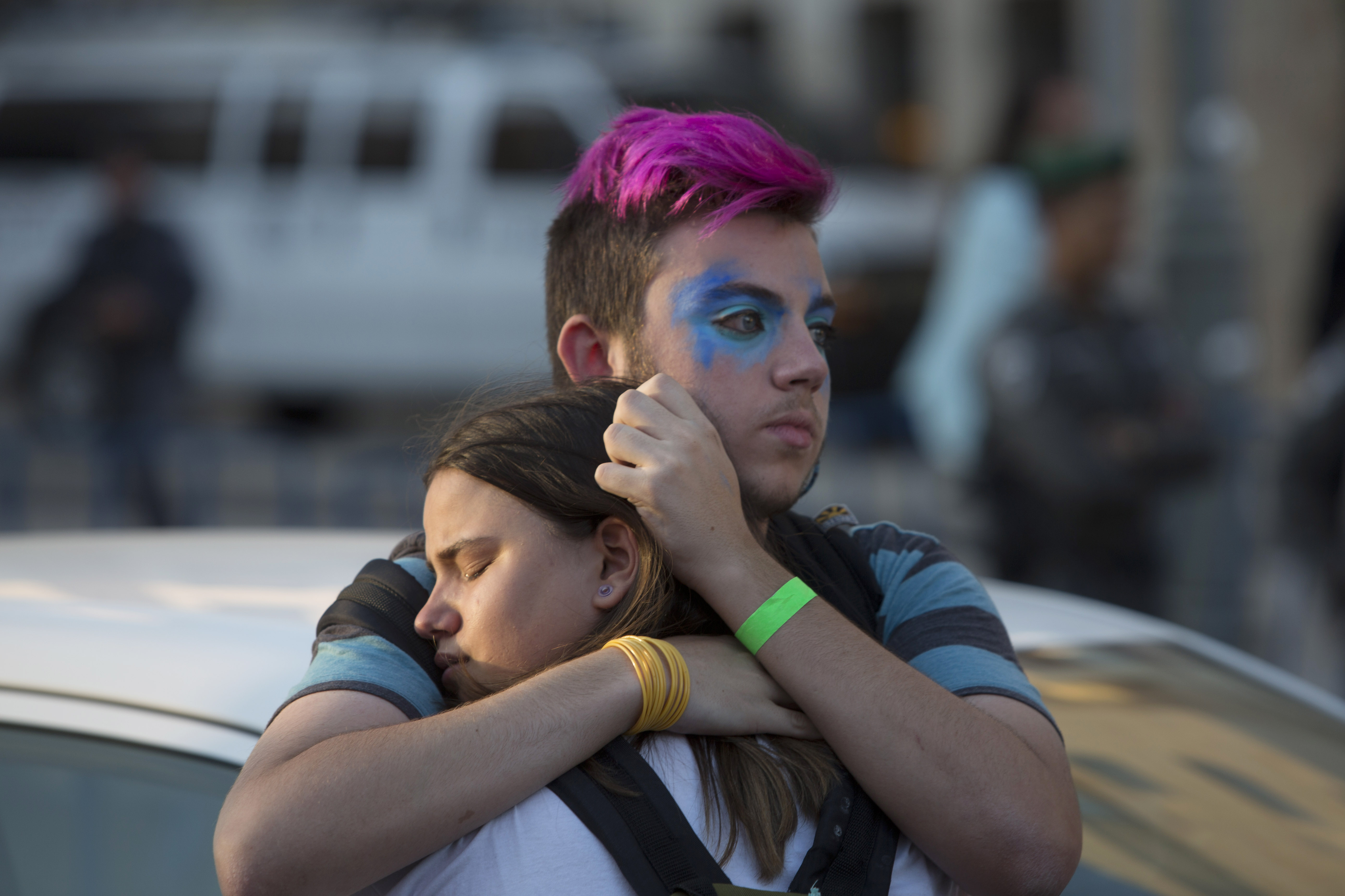 People react after an ultra-Orthodox Jew attacked people with a knife during a Gay Pride parade Thursday, July 30, 2015 in central Jerusalem. Israeli police said several people were stabbed. (AP Photo/Sebastian Scheiner)