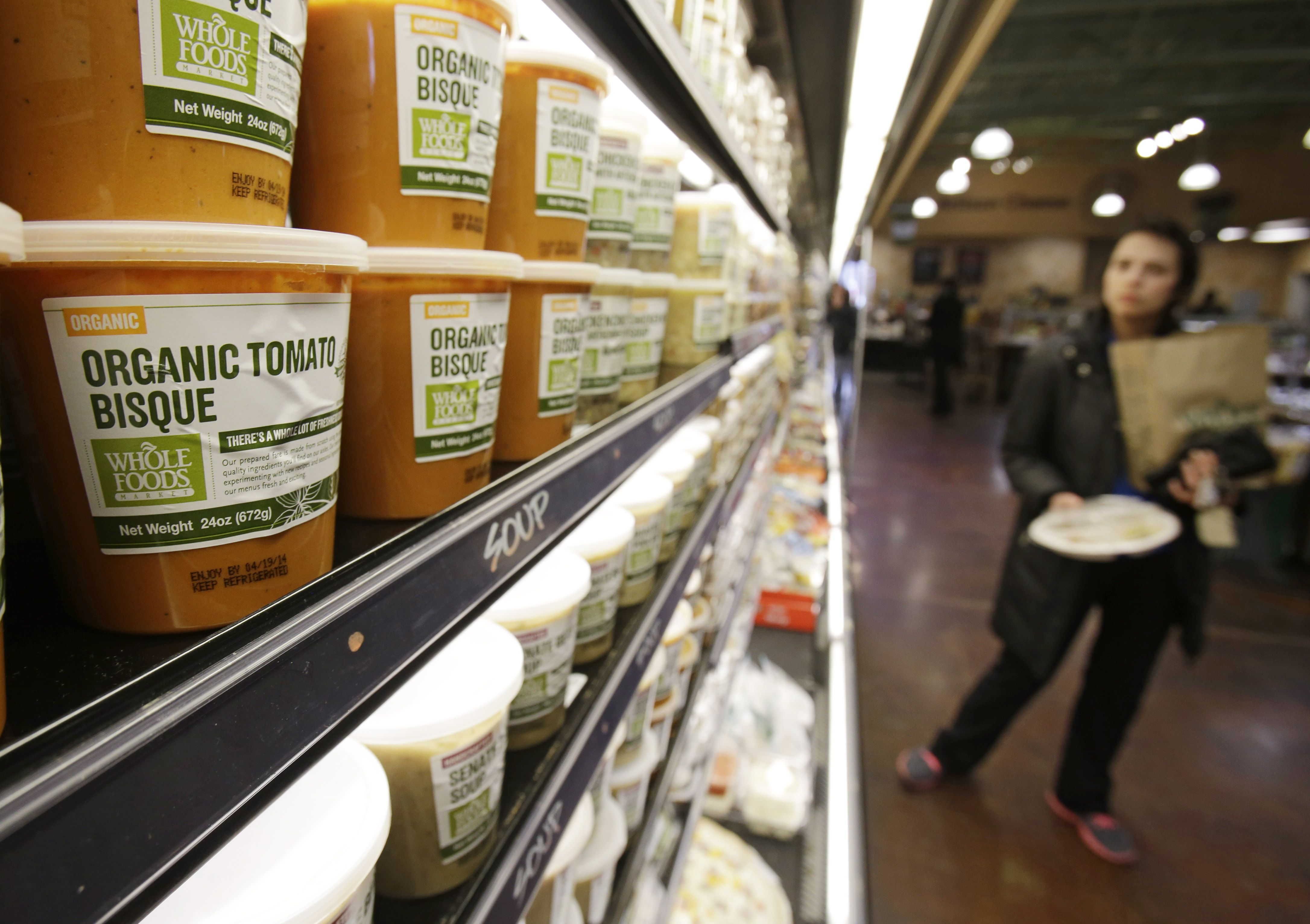 This Thursday, March 27, 2014 photo shows organic tomato bisque on the shelf at the Whole Foods Market in Woodmere Village, Ohio. Whole Foods Market Inc. reports quarterly financial results after the market closes on Wednesday, Feb. 11, 2015. (AP Photo/Tony Dejak)