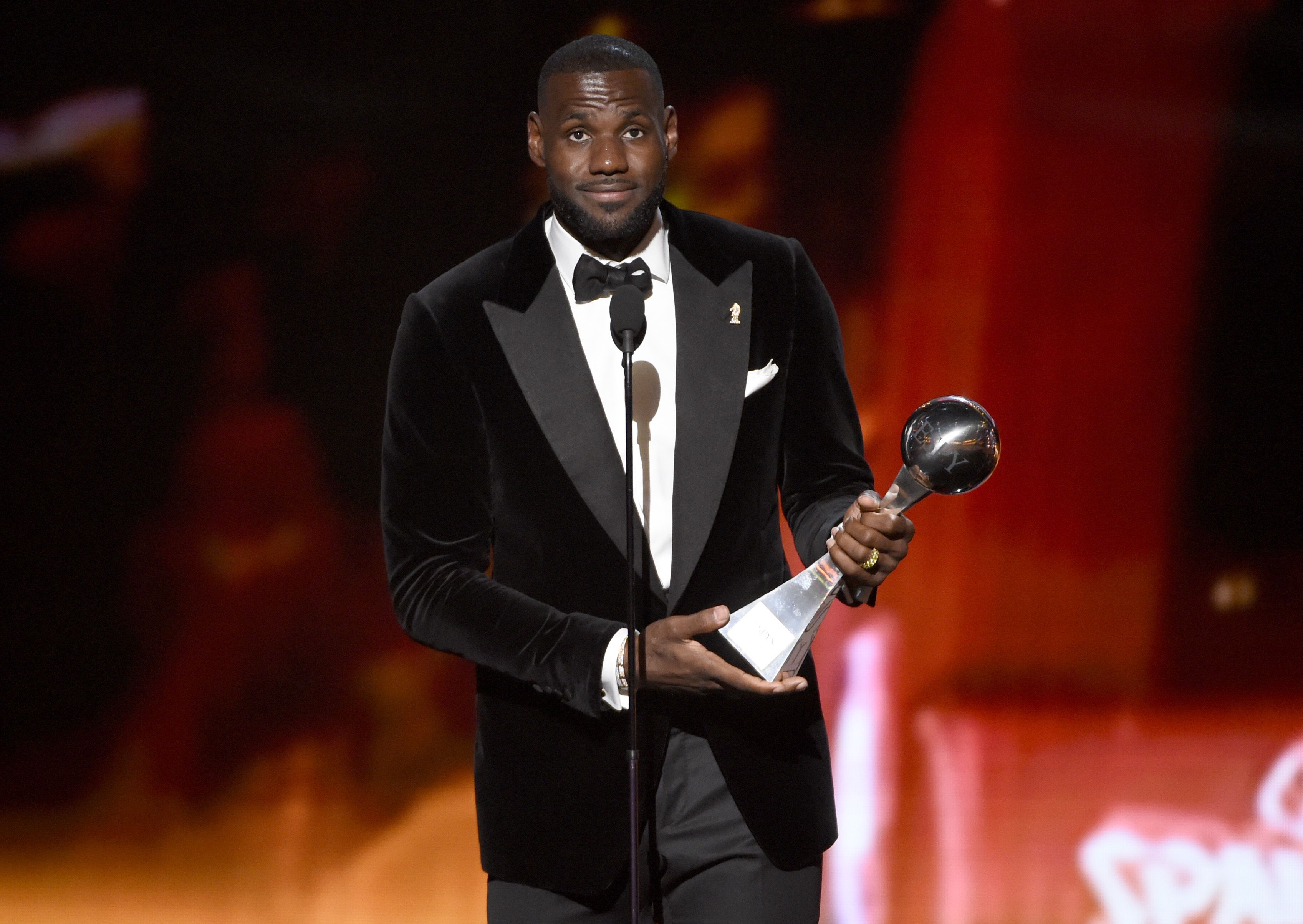 FILE - In this Wed., July 15, 2015 file photo, NBA player LeBron James, of the Cleveland Cavaliers, accepts the award for best championship performance at the ESPY Awards at the Microsoft Theater, in Los Angeles. The NBA star and his company, SpringHill Entertainment, have signed a content creation deal with Warner Bros. that includes potential projects in film, television and other digital properties. Warner Bros. Chairman and CEO Kevin Tsujihara announced the partnership Wednesday, July 22, 2015.