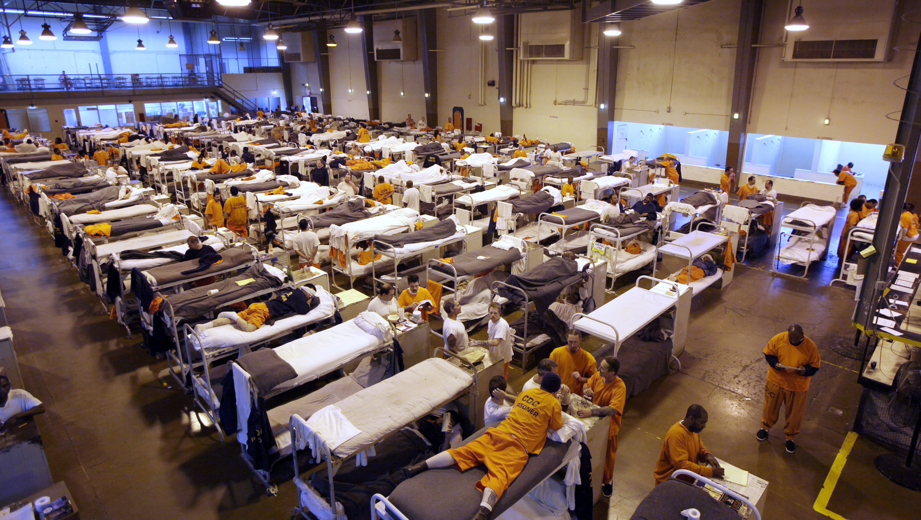 Inmates crowd the gymnasium at San Quentin prison in San Quentin, Calif. California on Monday, July 13, 2015.