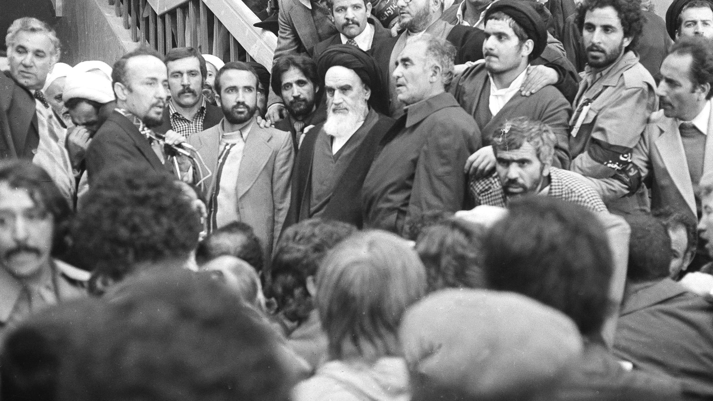 Ayatollah Ruhollah Khomeini, center, is surrounded by followers, Feb. 1, 1979, after his arrival at Mehrabad Airport after 14 years of exile.