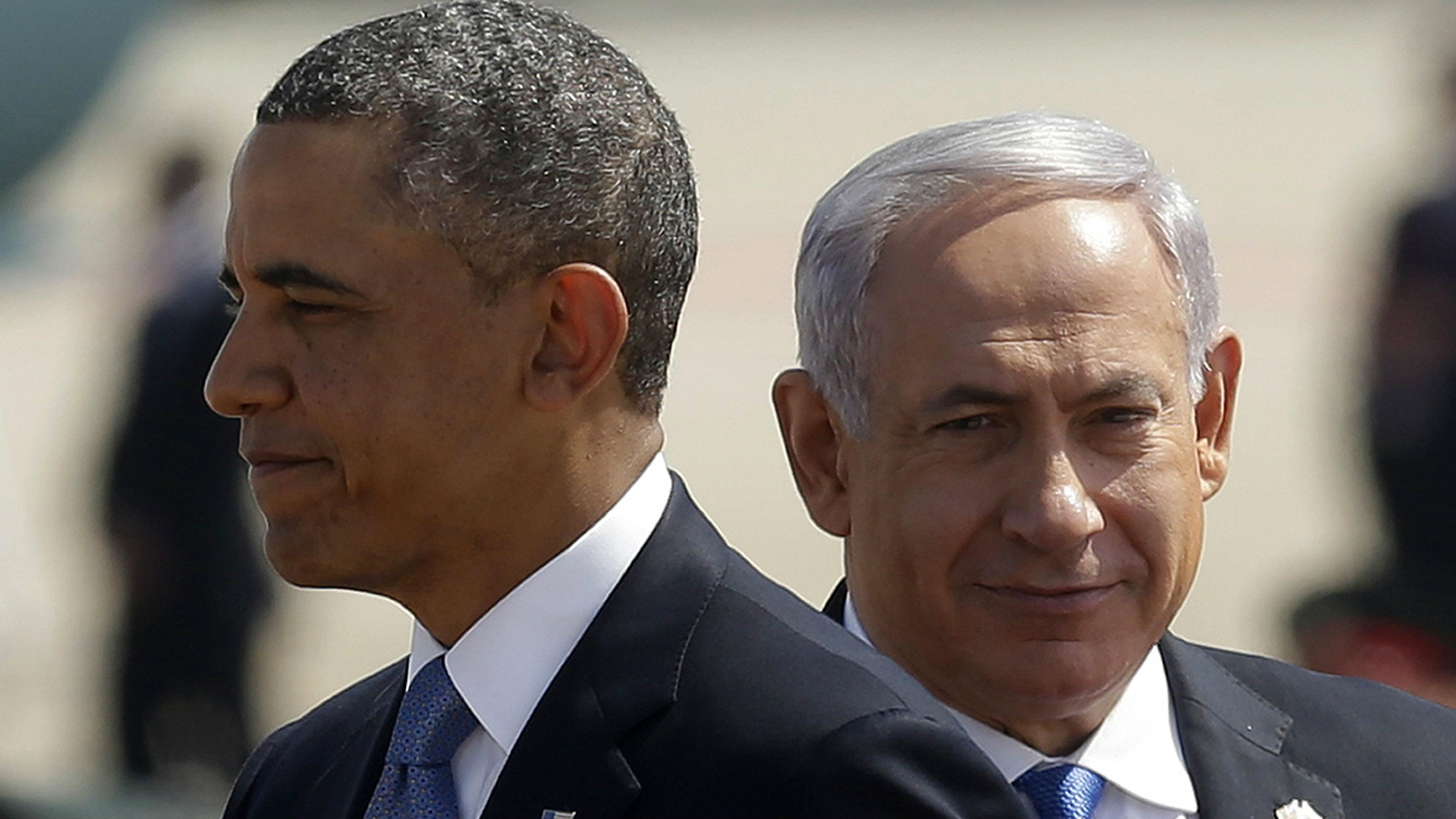 President Barack Obama, left, with Israeli Prime Minister Benjamin Netanyahu, right, during his arrival ceremony at Ben Gurion International Airport in Tel Aviv, Israel, Wednesday, March 20, 2013.