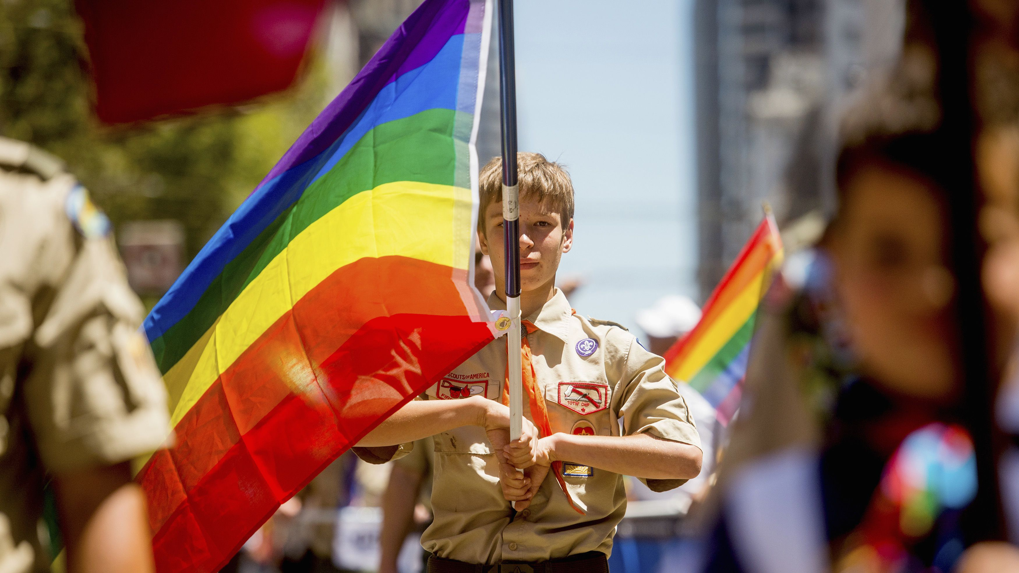 Boy Scout Casey Chambers carries a rainbow flag during the San Francisco Gay Pride Festival in California June 29, 2014. REUTERS/Noah Berger (UNITED STATES - Tags: SOCIETY TPX IMAGES OF THE DAY) - RTR3WCZI