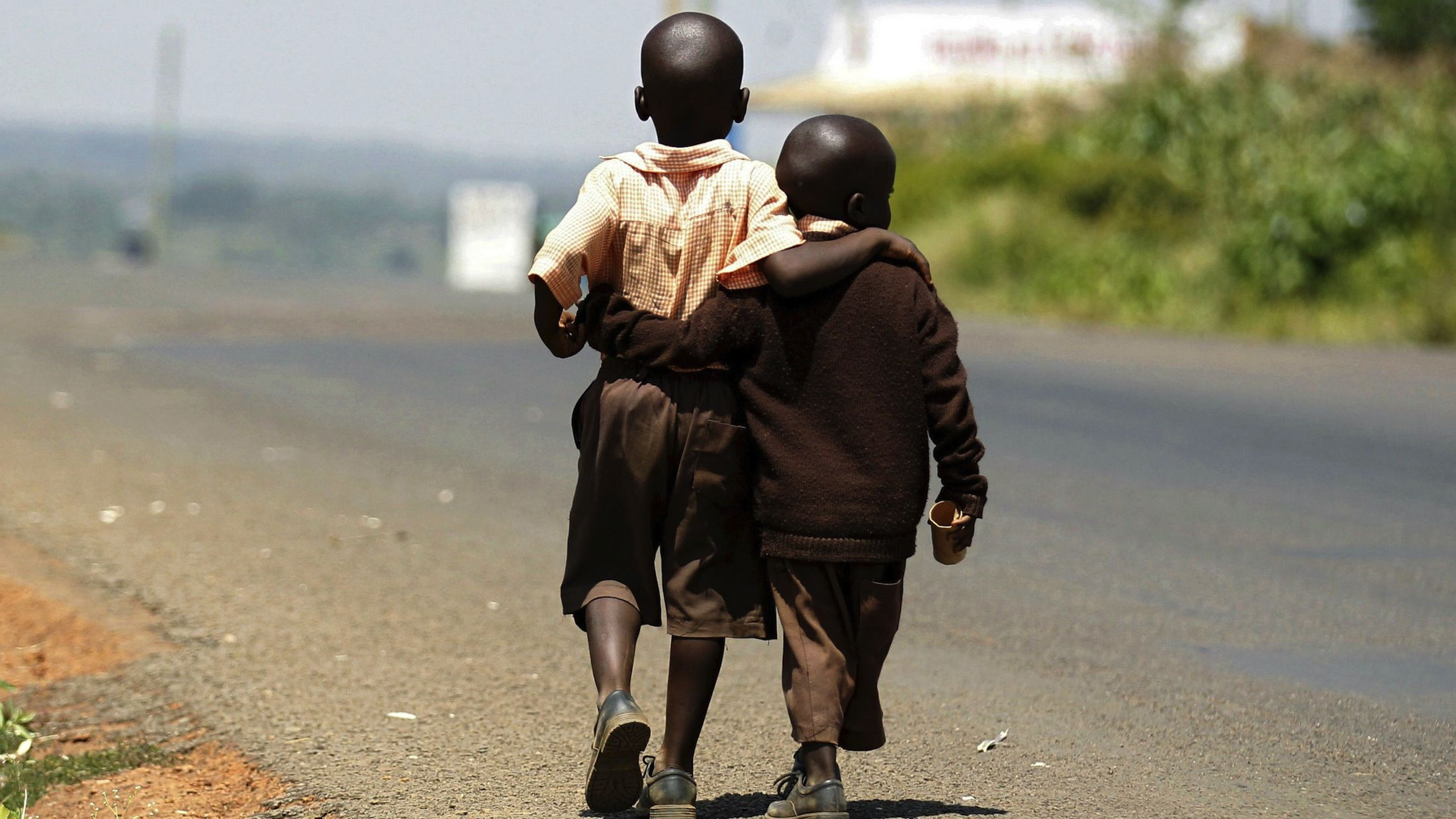 Boys in Kogelo, the hometown of Obama's father, walk home from school for lunch