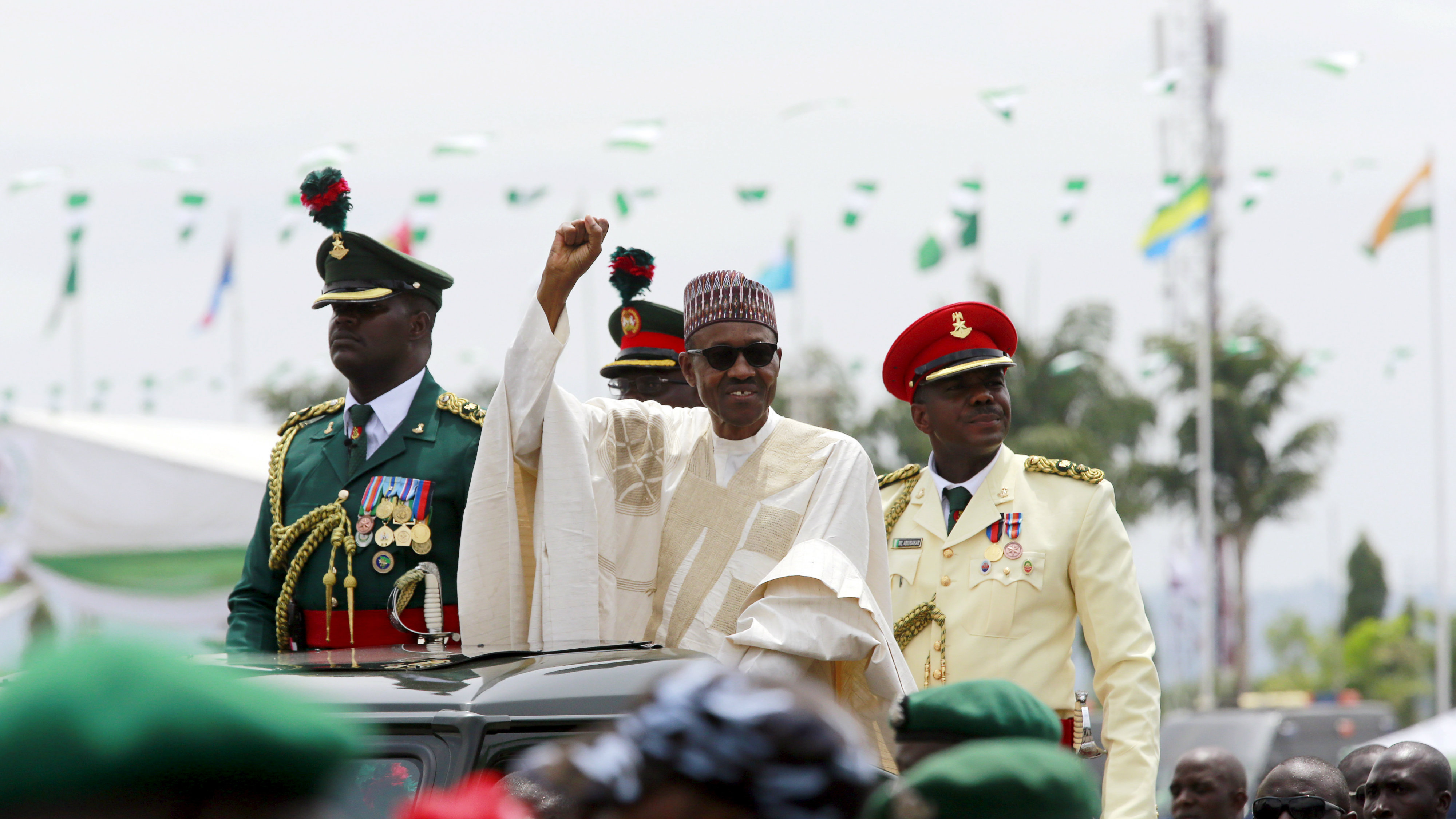 Nigeria's new President Muhammadu Buhari rides on the motorcade while inspecting the guard of honour at Eagle Square in Abuja, Nigeria May 29, 2015. REUTERS/Afolabi Sotunde