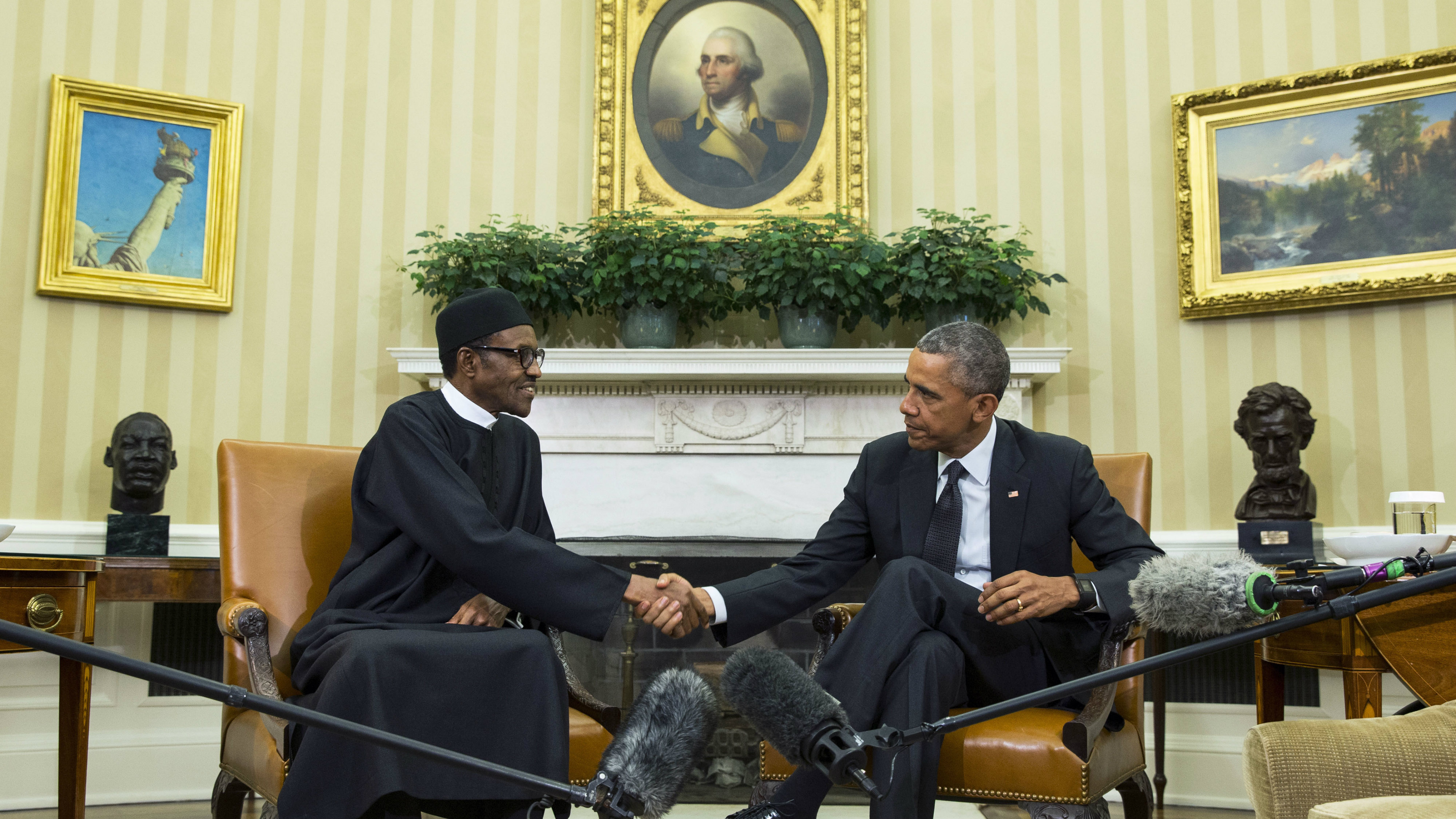 President Barack Obama, right, meets with Nigerian President Muhammadu Buhari, in the Oval Office of the White House, on Monday, July 20, 2015, in Washington. Buhari is seeking to shore up relations between the two countries and to request additional assistance in the fight against the Islamic extremist group Boko Haram. (AP Photo/Evan Vucci)