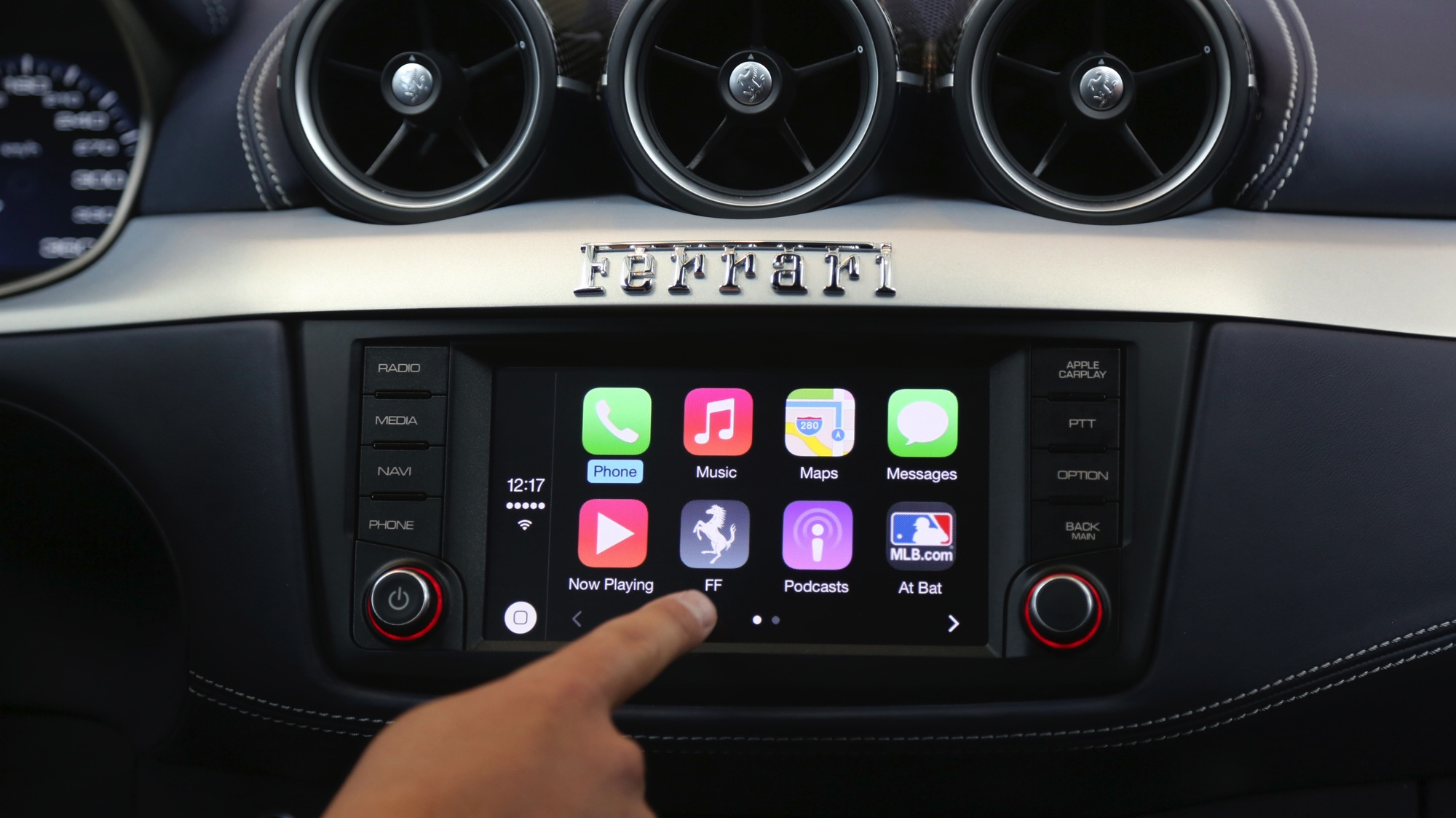 Apple's Stephen Chick displays the CarPlay program at the Worldwide Developers Conference in San Francisco, California June 2, 2014. REUTERS/Robert Galbraith (UNITED STATES - Tags: BUSINESS SCIENCE TECHNOLOGY)