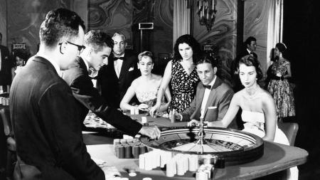 Roulette is one of the many gambling attractions for U.S. tourists in Havana. This Photo Shows a group of players as they watch the spin of the wheel in the International Casino at the Hotel Nacional de Cuba, September 23, 1958.