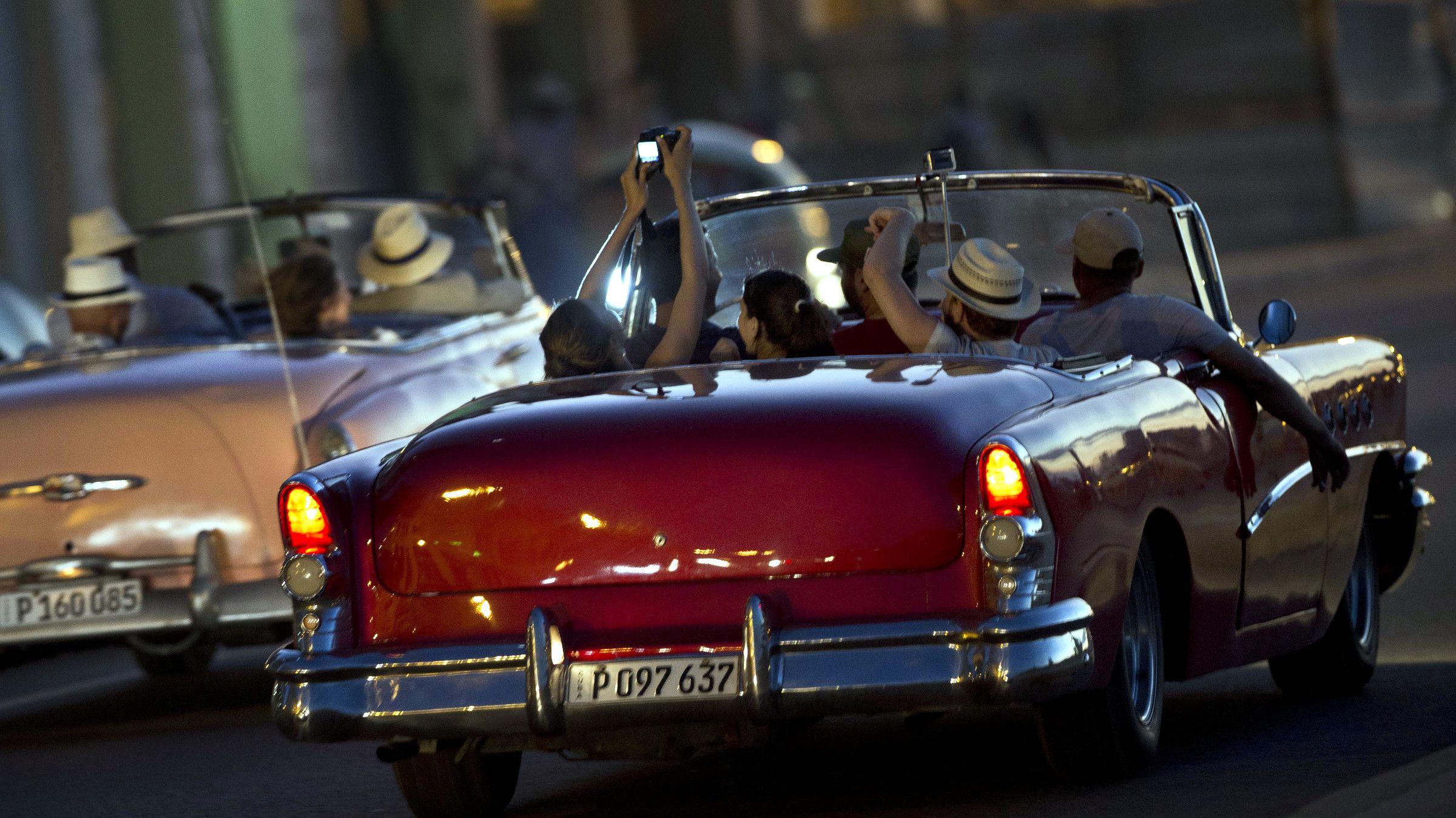 Tourists ride in vintage American convertible cars, on the Malecon in Havana, Cuba, Sunday, Dec. 28, 2014. Cuba and the U.S. announced on Dec. 17 that the two countries would resume diplomatic relations for the first time since 1961.