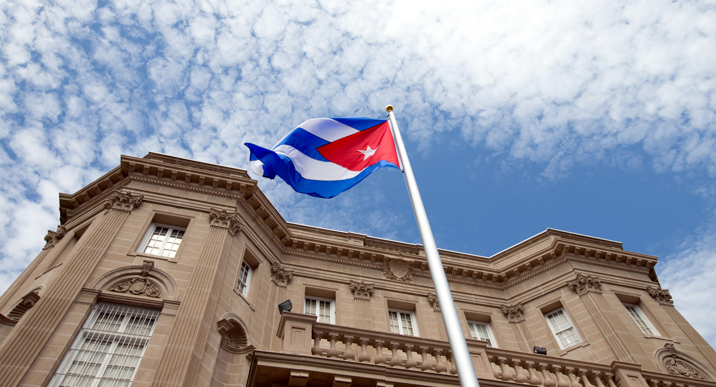 The Cuban flag is raised over their new embassy in Washington, Monday, July 20, 2015. Cuba's blue, red and white-starred flag was hoisted Monday at the country's embassy in Washington in a symbolic move signaling the start of a new post-Cold War era in U.S.-Cuba relations.