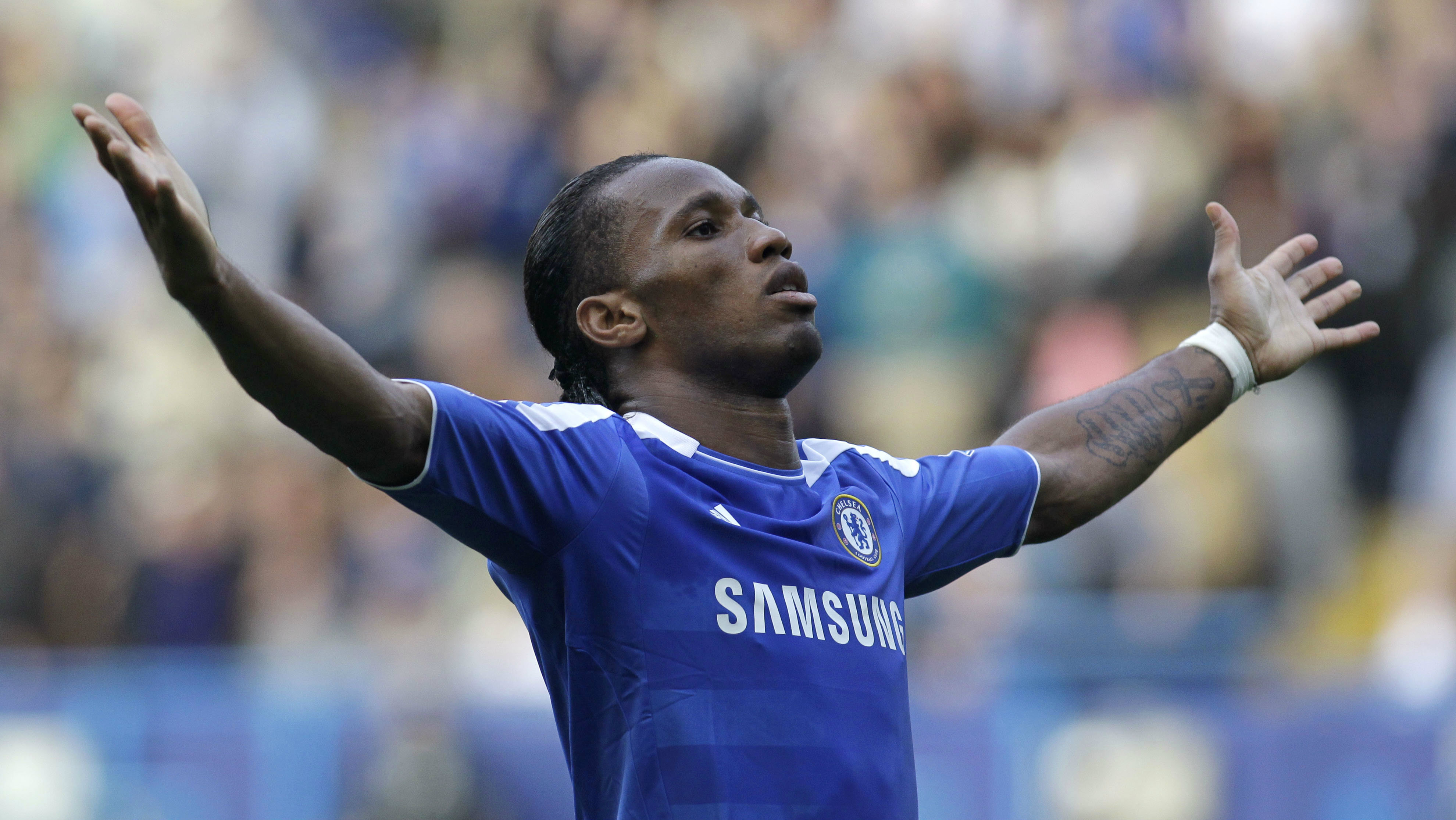 Chelsea's Didier Drogba celebrates his goal against Stoke City during their English Premier League soccer match at Stamford Bridge, London, Saturday, March 10, 2012.