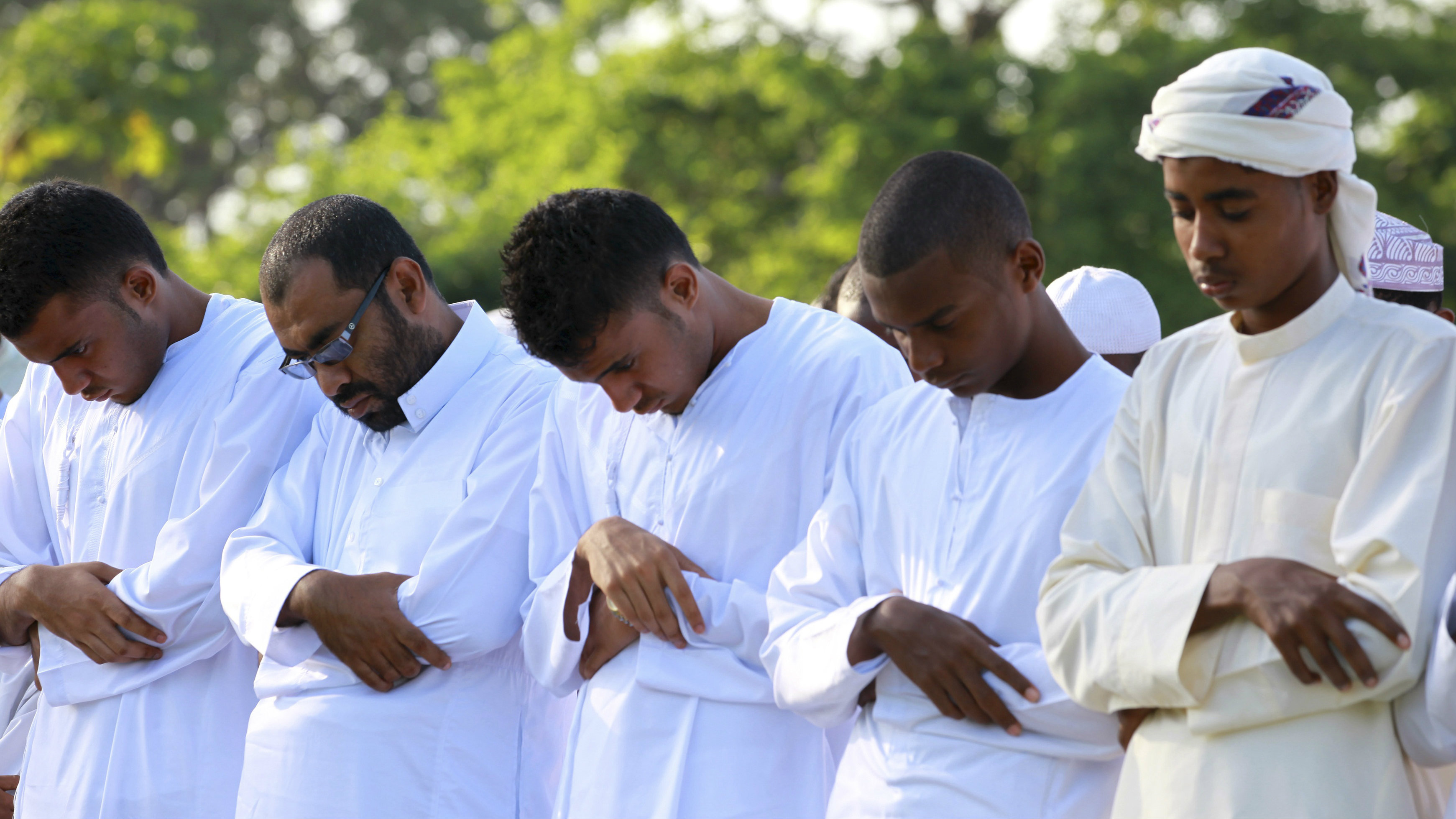 Muslims attend Eid al-Fitr prayers at Ziwani grounds in Kenya's coastal town of Mombasa August 9, 2013. Eid al-Fitr marks the end of the holy month of Ramadan.
