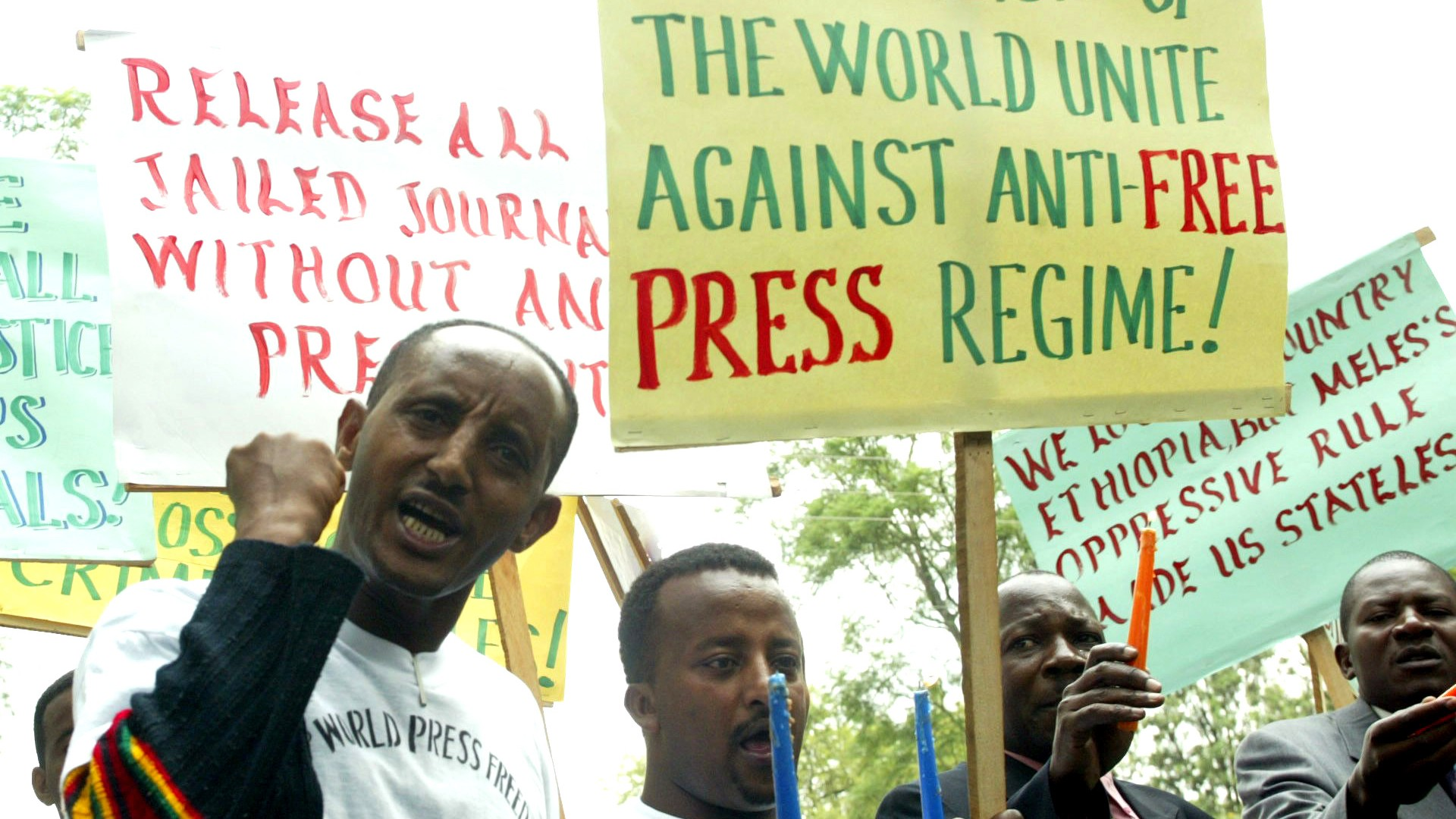 Ethiopian journalists hold placards as they shout slogans during a demonstration at the Ethiopian Embassy in Nairobi, Tuesday, May 2, 2006.