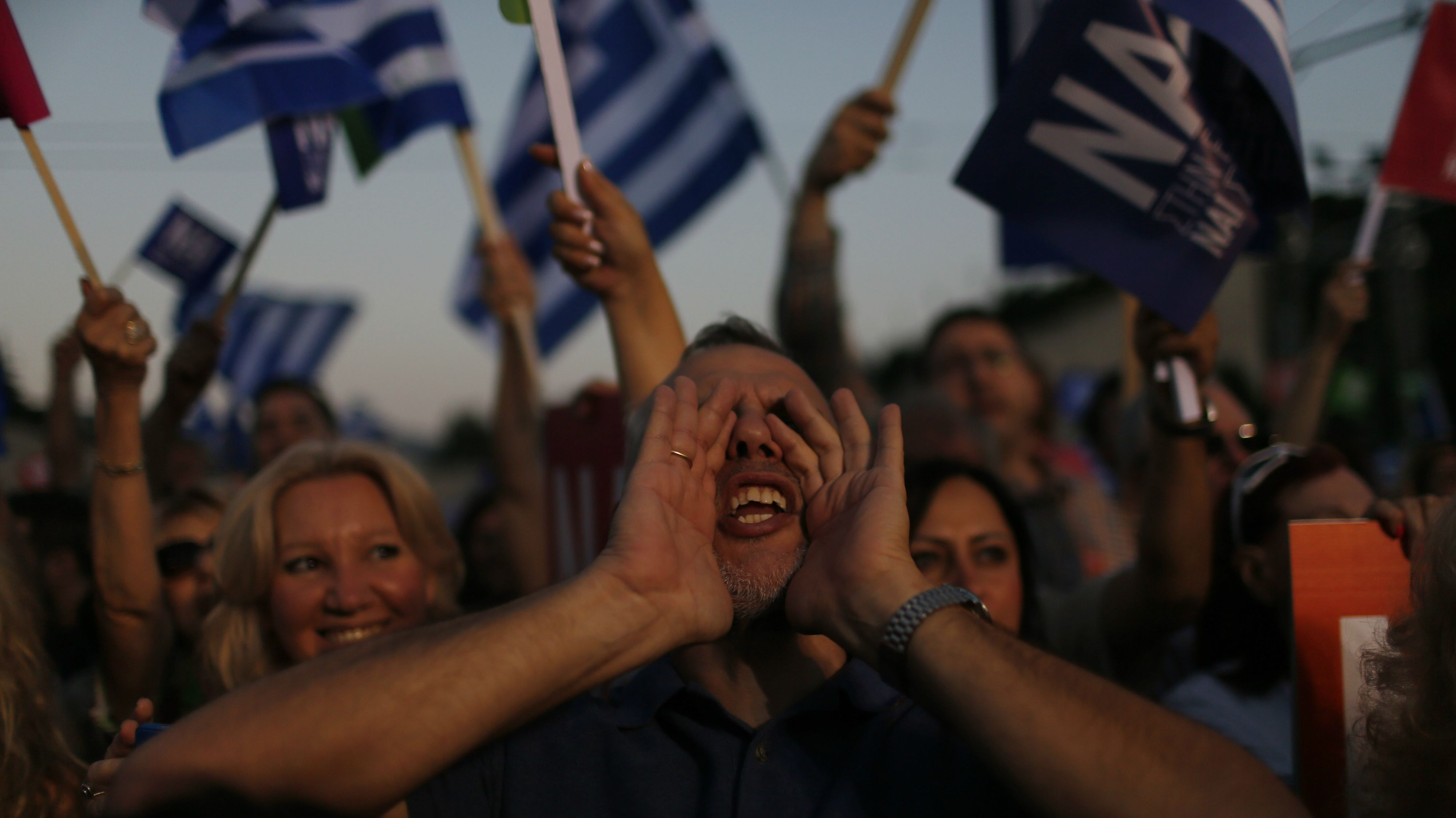 A demonstrator shouts slogans during a rally organized by supporters of the Yes vote in Athens, Friday, July 3, 2015. A new opinion poll shows a dead heat in Greece's referendum campaign with just two days to go before Sunday's vote on whether Greeks should accept more austerity in return for bailout loans. (A demonstrator shouts slogans during a rally organized by supporters of the Yes vote in Athens, Friday, July 3, 2015. A new opinion poll shows a dead heat in Greece's referendum campaign with just two days to go before Sunday's vote on whether Greeks should accept more austerity in return for bailout loans. (AP Photo/Emilio Morenatti