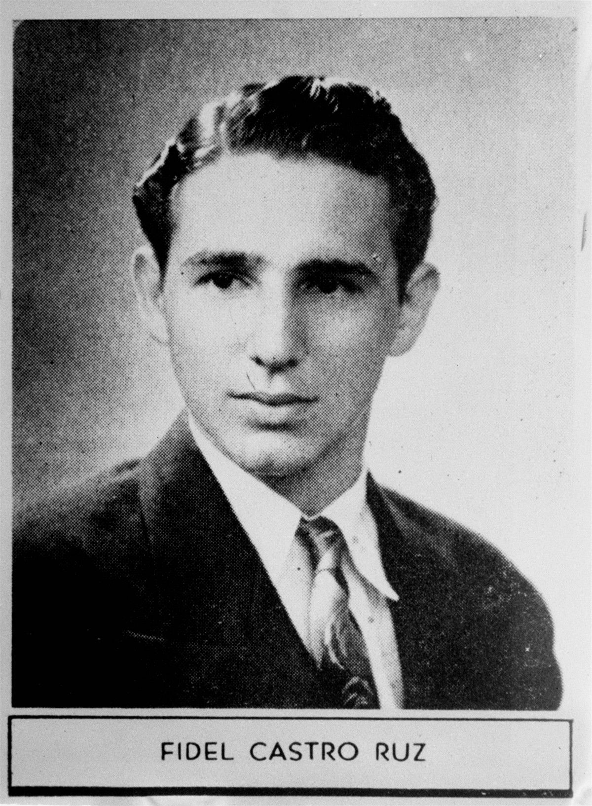 """The caption describing Fidel Castro in his 1945 high school yearbook reads: """"Distinguished student and a fine athlete. Very popular. Will study law and we have no doubt he will have a brilliant future."""""""