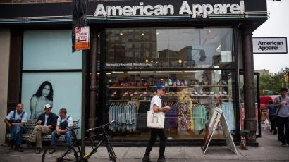 NEW YORK, NY - JUNE 19: People walk past an American Apparel store on June 19, 2014 in New York City.