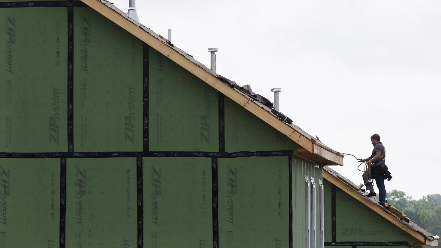 A roofer works on a home under construction in the Briar Chapel community in Chapel Hill, North Carolina.