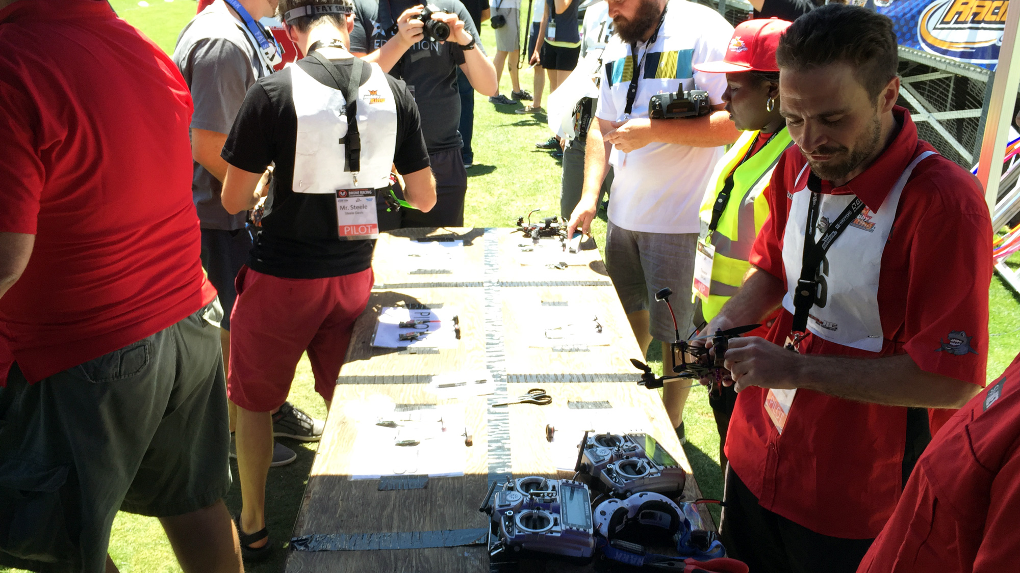 FPV drone-racing champion Nowak (right) prepares his drone for his last race.