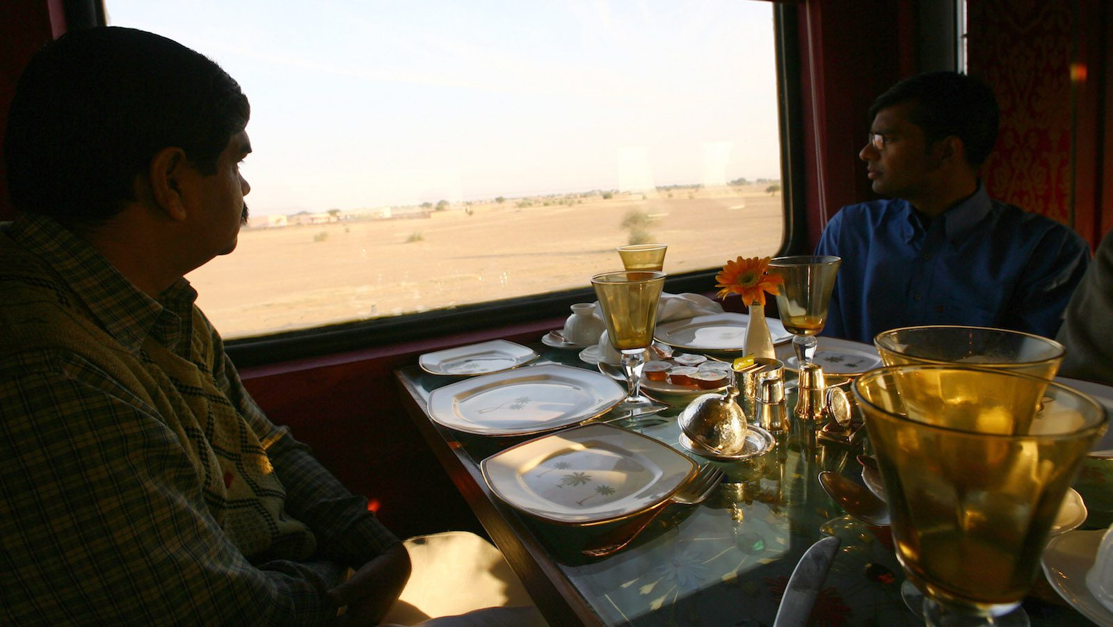 Guests sit inside the Swarna Mahal of the new luxury train on the outskirts of Jaisalmer