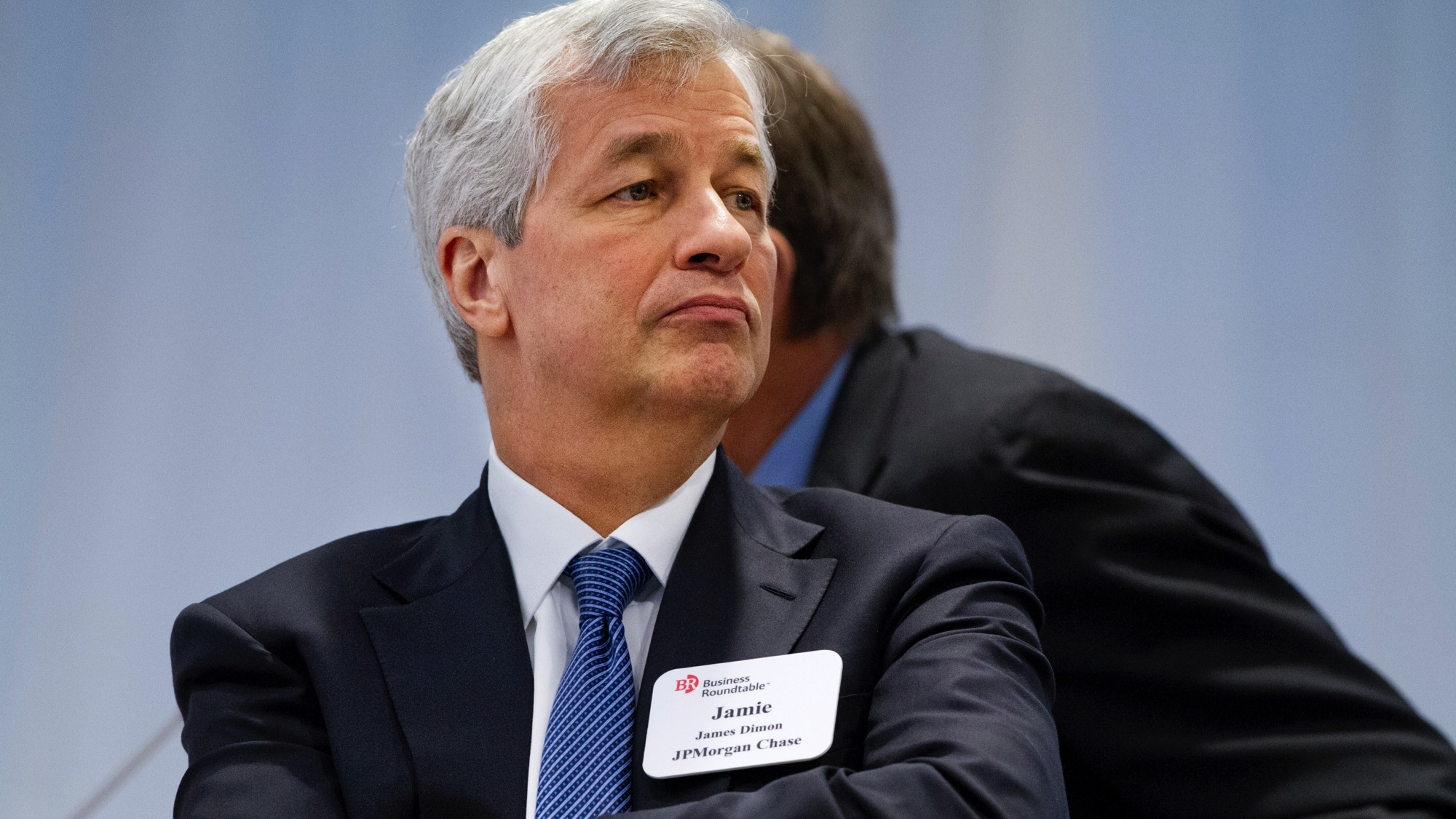 JPMorgan Chase Chairman and CEO Jamie Dimon listens as President Barack Obama speaks to leading CEOs to discuss ways to promote the economy and create jobs during the president's last two years in office, Wednesday, Dec. 3, 2014, at the Business Roundtable Headquarters in Washington. (AP Photo/Jacquelyn Martin)