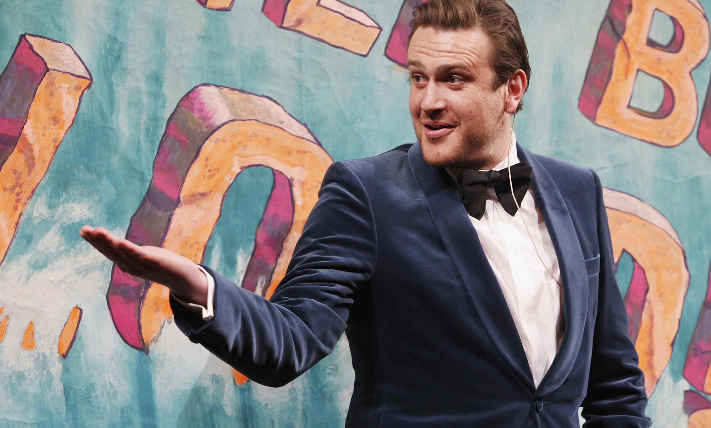 "Actor Jason Segel gestures to Hasty Pudding Theatricals cast members as he is honoured as the ""Hasty Pudding Theatricals Man of the Year"" at Harvard University in Cambridge, Massachusetts February 3, 2012."