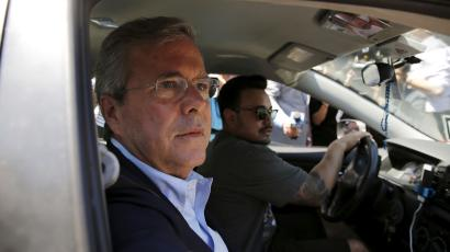 Republican presidential candidate Jeb Bush takes an Uber vehicle as he departs an appearance at Thumbtack, a consumer service connecting experienced professionals, in San Francisco, California July 16, 2015.