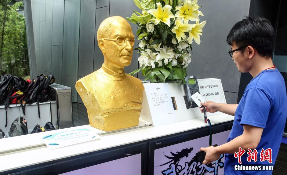 A golden bust of Steve Jobs displayed at a Shanghai Company