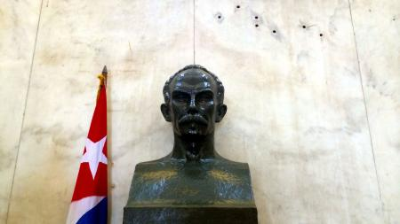 A bust of Jose Marti and bullet holes in the museum of the revolution.