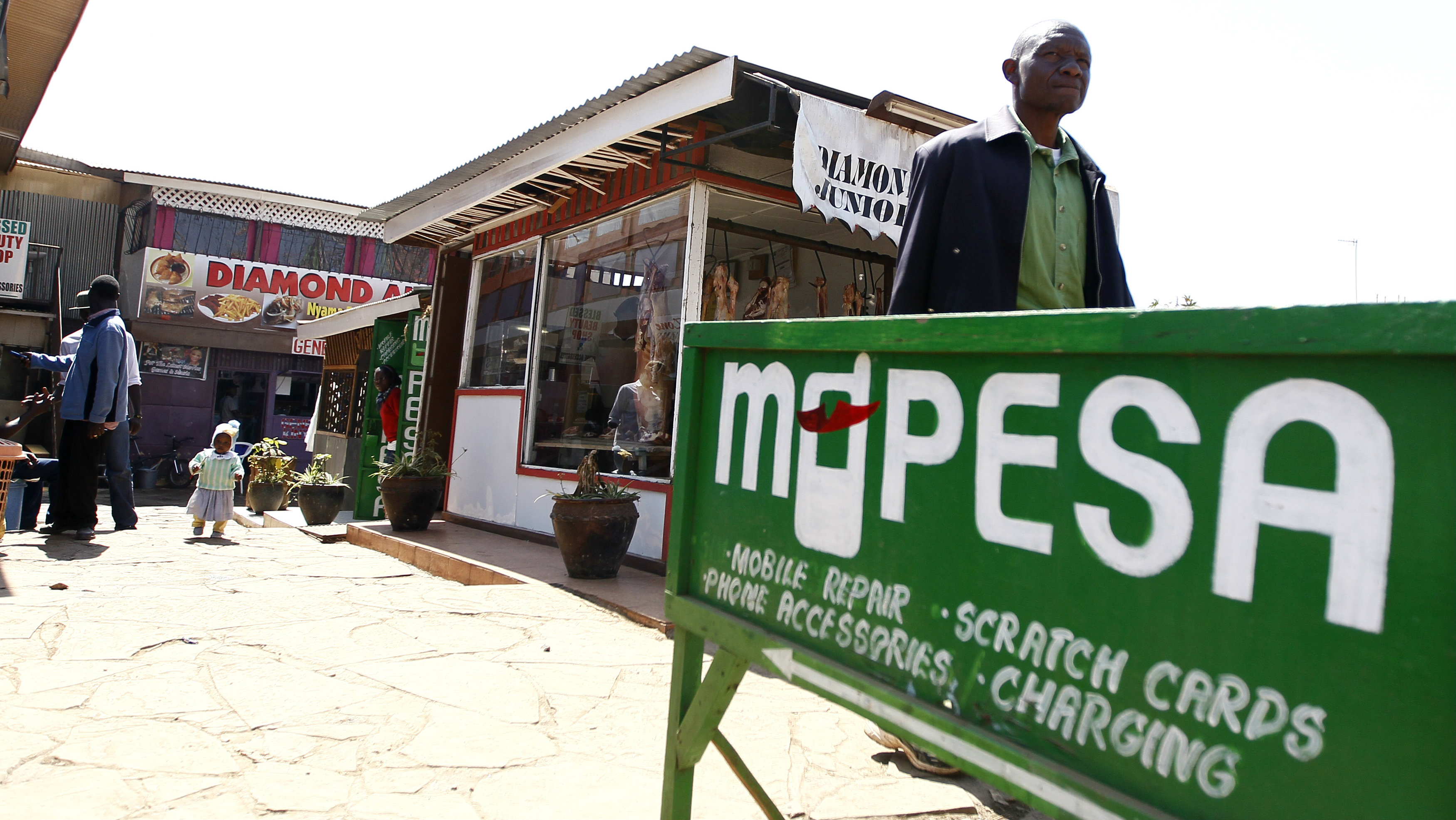 A man walks away from a retail mobile money transfer shop in Ngong township in the outskirts of Kenya's capital Nairobi July 15, 2013.