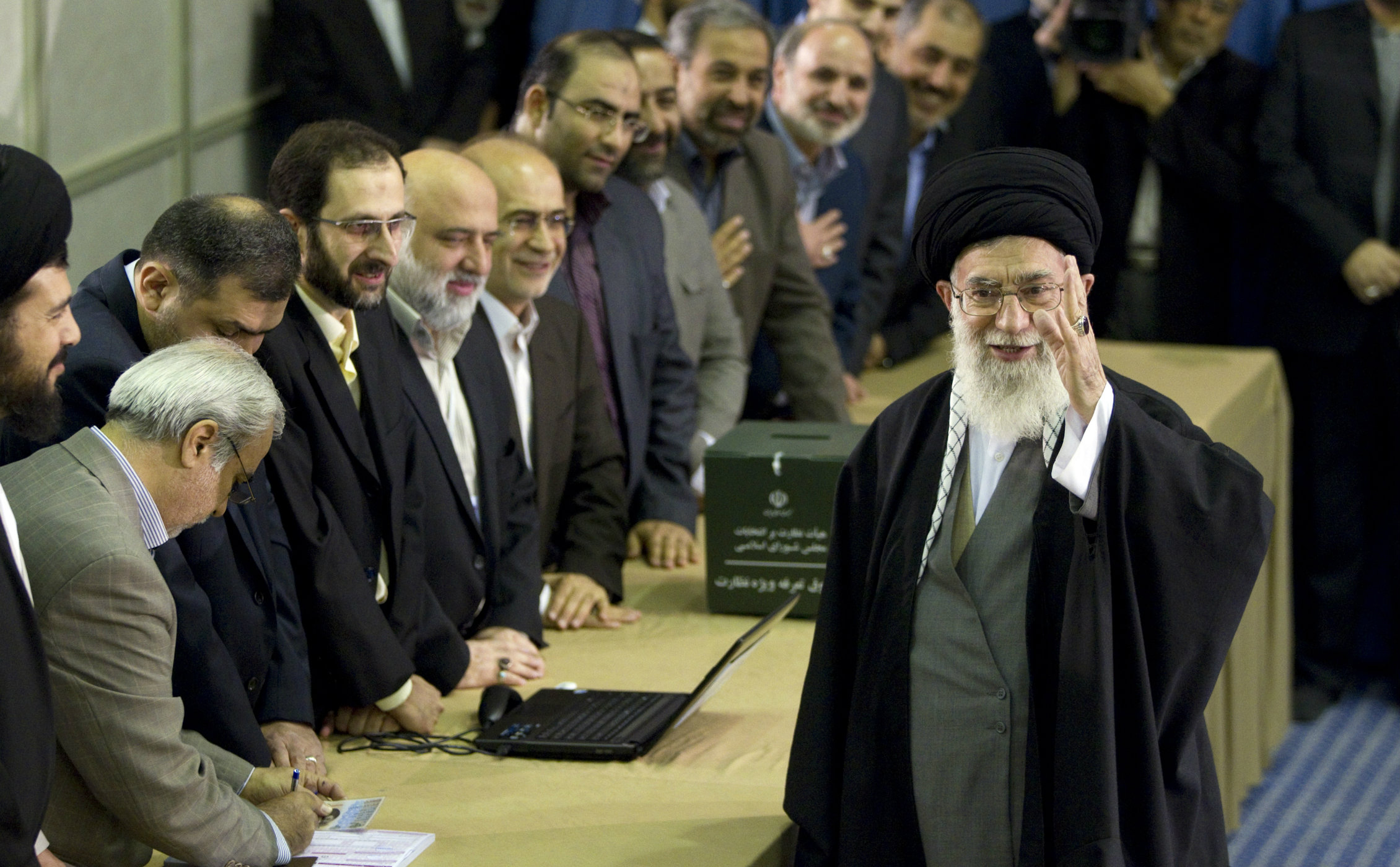 ran's Supreme Leader Ayatollah Ali Khamenei waves to the media after presenting his identification papers to cast his ballot in the parliamentary election in Tehran March 2, 2012. Polls opened on Friday for a parliamentary election in Iran that will test the popularity of the clerical establishment at a time of a standoff with the West over the country's nuclear programme. REUTERS/Caren Firouz