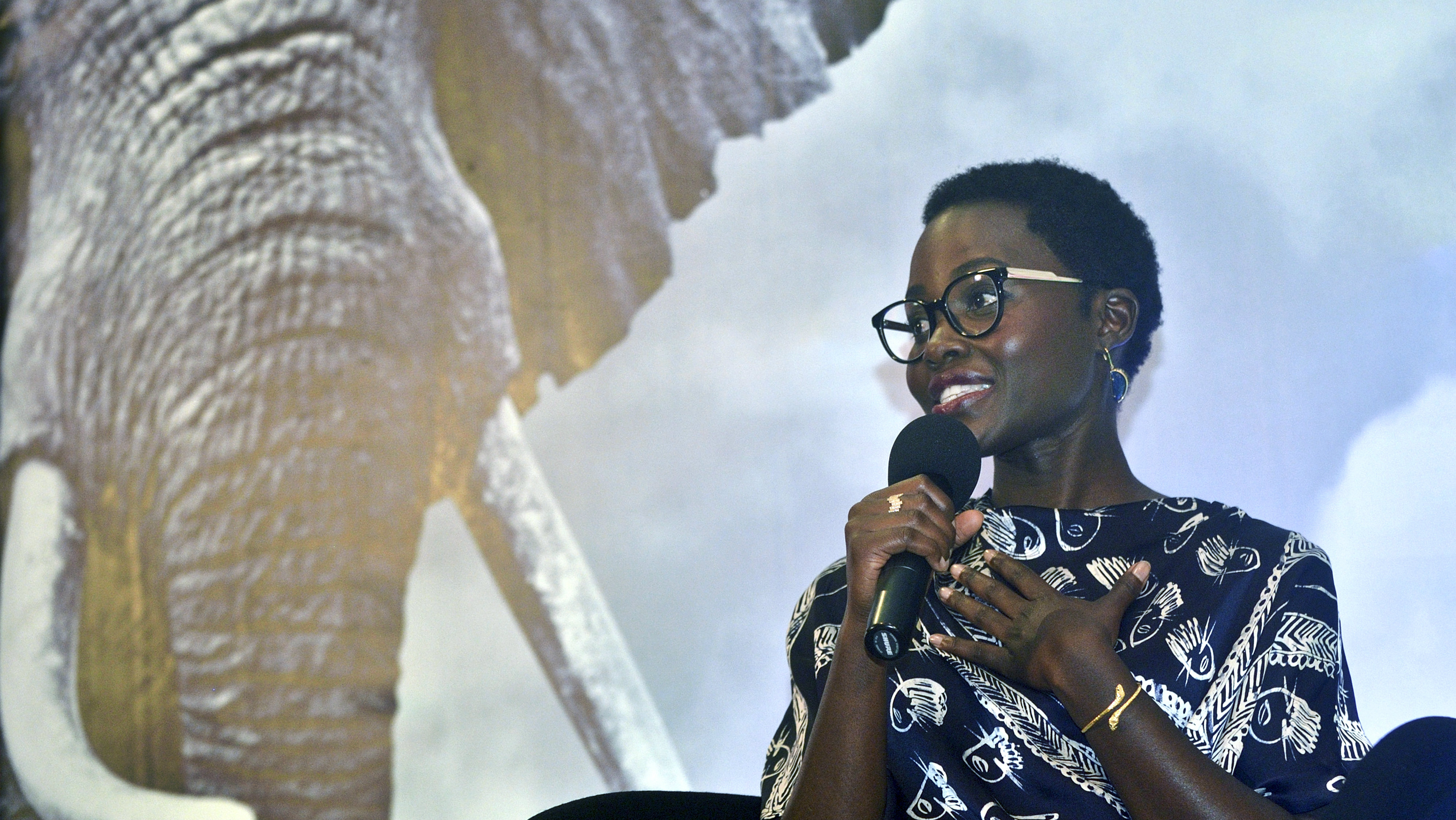 In this photo taken Tuesday, June 30, 2015, Kenyan actress and director Lupita Nyong'o, who was born in Mexico, speaks at a press conference where she announced that she will work as an ambassador for the international conservation organization WildAid, in Nairobi, Kenya. According to WildAid, Lupita Nyong'o will campaign to reduce the global consumption of wildlife products, and particularly against poaching and the trade in elephant ivory. (AP Photo)