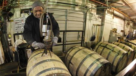 man with whiskey barrels