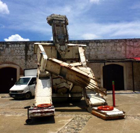 A giant sculpture lurks in Havana's La Cabana fort during the Bienal.