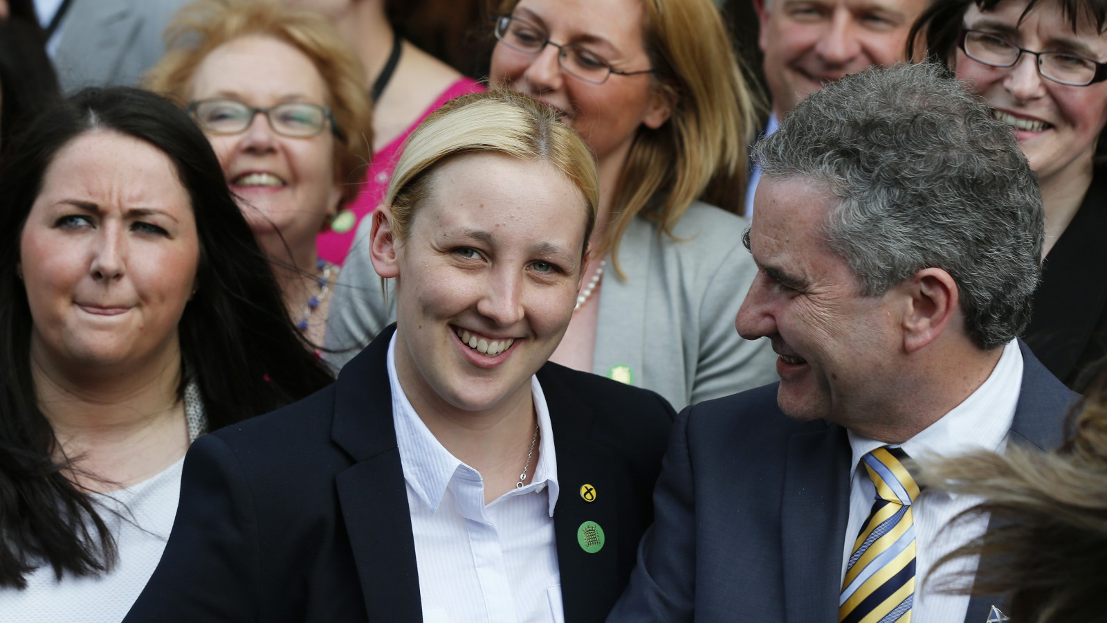 Scottish National Party MP, Mhairi Black (C), poses with other newly-elected SNP MPs, in central London, Britain May 11, 2015.    REUTERS/Suzanne Plunkett  - RTX1CG50