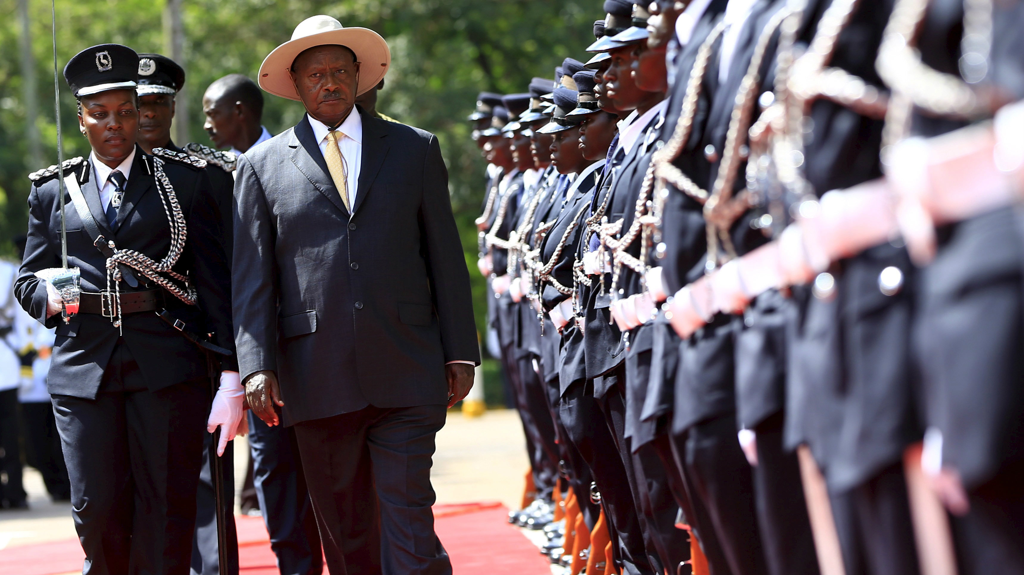 Uganda's President Yoweri Museveni inspects the guard of honour upon his arrival to deliver his state of the nation address in the capital Kampala June 4, 2015.
