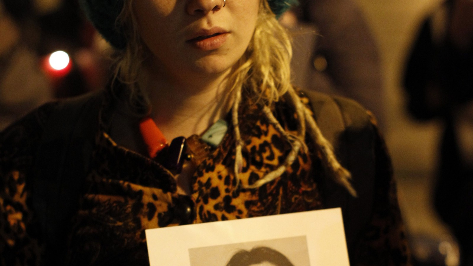 A woman holds a picture of Savita Halappanavar during a candle lit vigil outside Belfast City Hall, Northern Ireland, Thursday, Nov. 15, 2012, for Savita Halappanavar, the 31-year old Indian woman who was 17-weeks pregnant when she died of blood poisoning after suffering a miscarriage in Galway, Ireland, on 28 October.  Savita Halappanavar's father, Andanappa Yalagi, said the combination of medical negligence and Irish abortion laws led to his daughter's death.  The parents of an Indian woman who suffered a miscarriage and died after being refused an abortion in an Irish hospital slammed Ireland's abortion laws Thursday. (AP Photo/Peter Morrison)