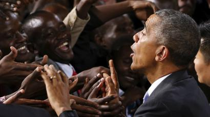 Obama greets a crowd after giving a speech in Nairobi.