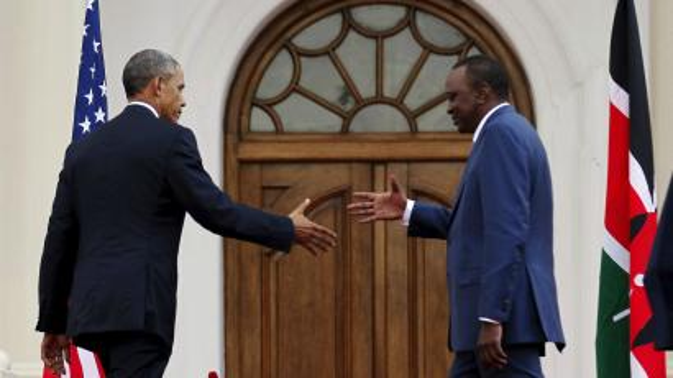 Obama shakes hands with Kenya's president Uhuru Kenyatta in Nairobi.