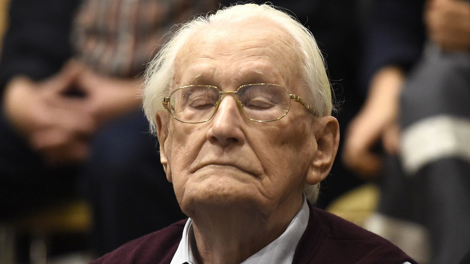 94-year-old former SS sergeant Oskar Groening listens to the verdict of his trial.