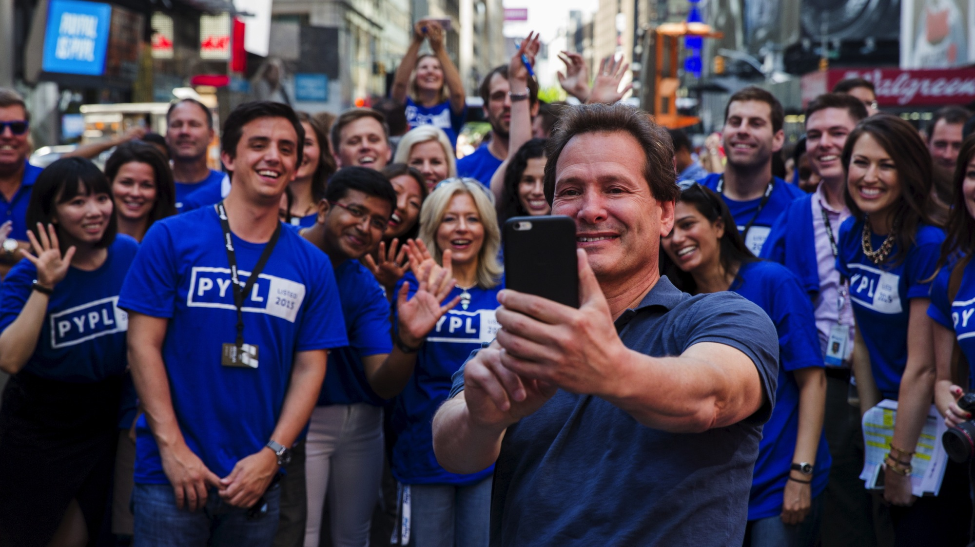 Paypal CEO Dan Schulman (C) celebrates with employees after the company's relisting on the Nasdaq in New York, July 20, 2015.