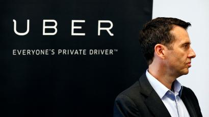 David Plouffe, Uber senior vice president of policy and communications, listens as Arizona Gov. Doug Ducey speaks at the opening of the new Uber offices Thursday, June 11, 2015, in Phoenix. The ride-hailing firm opens their new customer service center that is expected to eventually have several hundred employees. ()