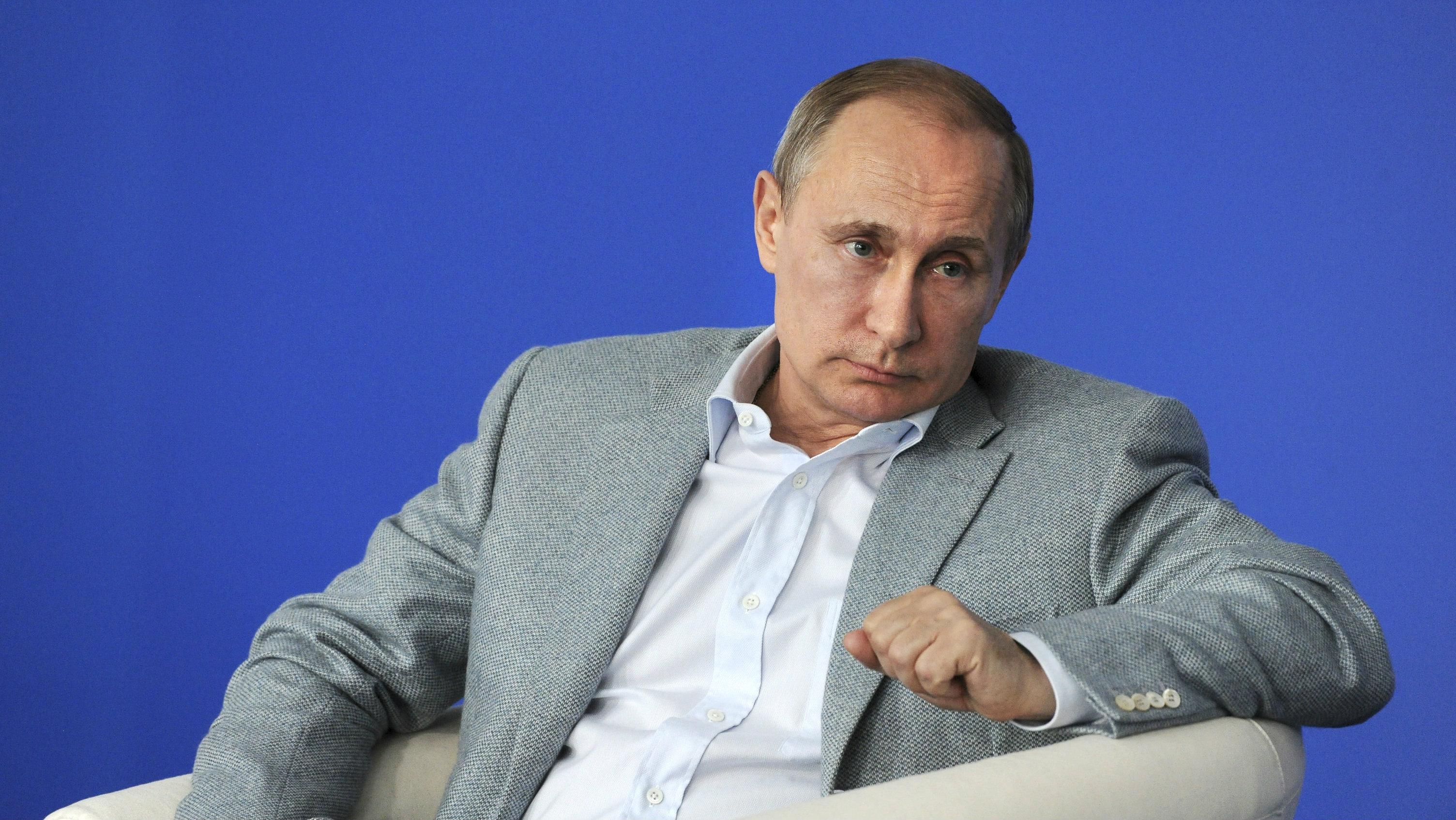 Russian President Vladimir Putin attends an educational youth forum in Vladimir region, Russia July 14, 2015.