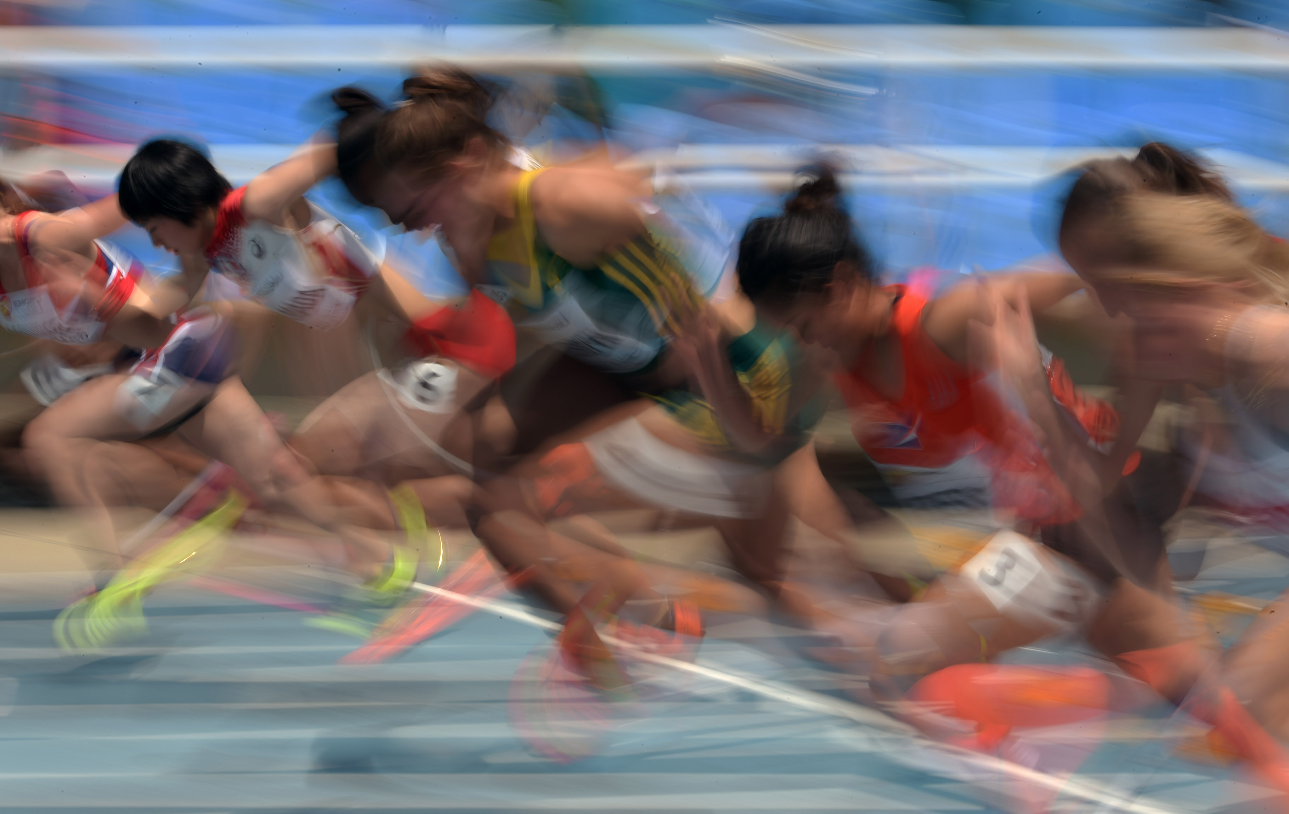 Jul 16, 2015, Cali, Columbia; General view of sprinters in the starting blocks of a womens 100m heat during the 2015 IAAF World Youth Championships at Estadio Olimpico Pascual Guerrero. From left: Helene Ronningen (NOR), Miku Yamada (JPN), Brianne Bethel (BAH), Nicole DeBruyn (RSA), Marlana Cress (MHL), Martina Miroska (HKD) and Arielle Tessier (CAN). Mandatory Credit: Kirby Lee-USA TODAY Sports