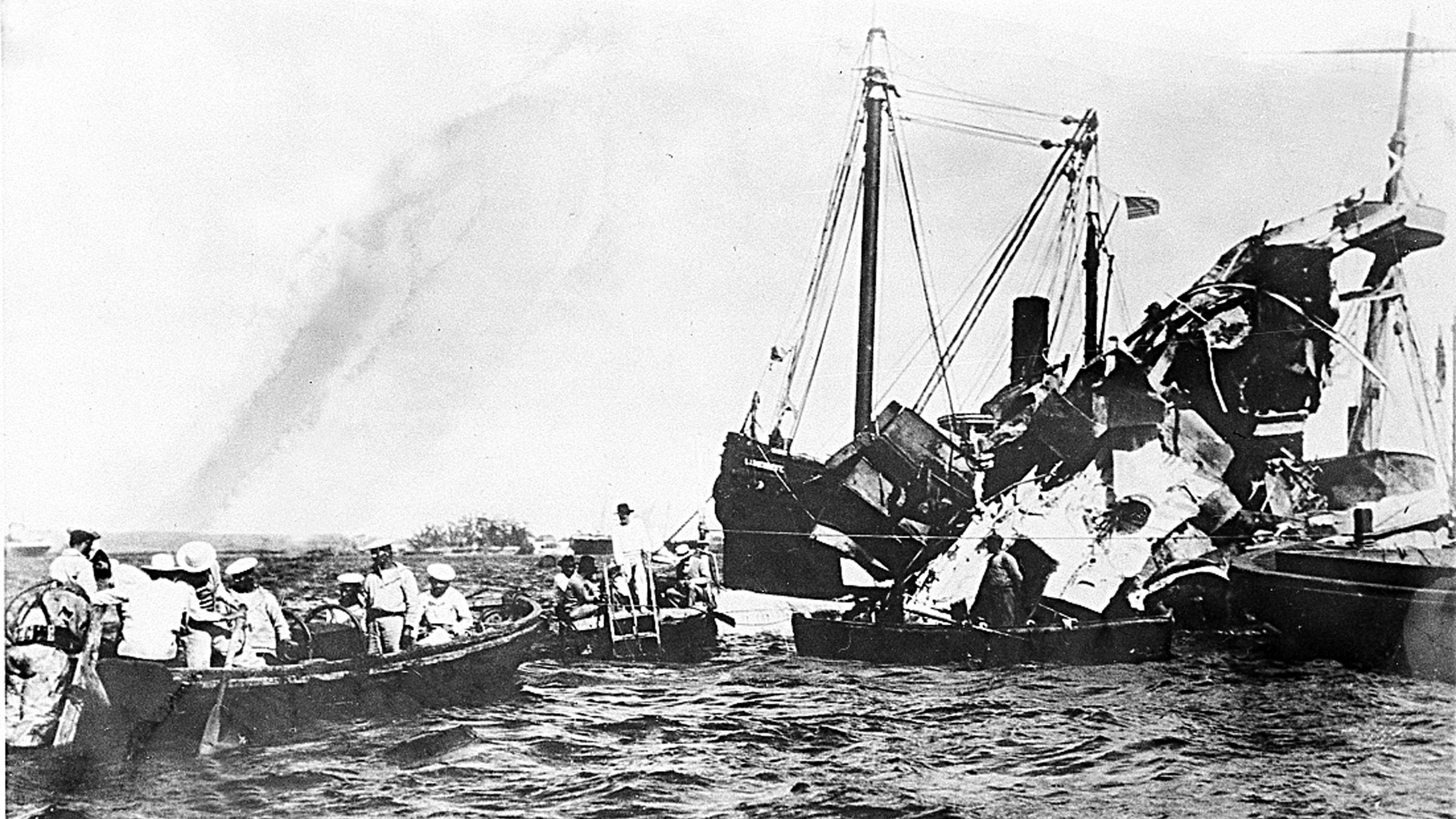 Lifeboats rescue surviving crewmen of the wrecked USS Maine after an underground explosion destroyed the battleship on the night of Feb. 15 as it was anchored in the Havana harbor, Cuba, in 1898. About 260 U.S. Naval personnel were killed in the explosion. The sinking of the U.S. warship was a catalyst for the outbreak of the Spanish-American War and the U.S. officially waged war on April 25.