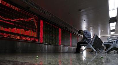 DATE IMPORTED:July 06, 2015An investor takes notes as he watches a board showing stock prices at a brokerage office in Beijing, China, July 6, 2015. China's key stock indexes showed signs of stabilizing on Monday, rising close to 3 percent, in response to unprecedented rescue measures announced over the weekend. REUTERS/Kim Kyung-Hoon